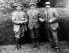 FILE - American golfer Francis B. Ouimet, center, shakes hands with Harry Vardon, left, and Ted Ray, both of Britain, at the U.S. Open Golf Championship at The Country Club in Brookline, Mass., in this 1913 file photo. Ouimet defeated the pair to become the new champion. In the tough, rainy conditions at Brookline, Ouimet played his best golf. He shot 72, while Vardon had a 78 and Ray shot 79. The gallery was among the biggest ever in America for a golf tournament, and it was hailed as one of the biggest upsets in sport. (AP Photo)