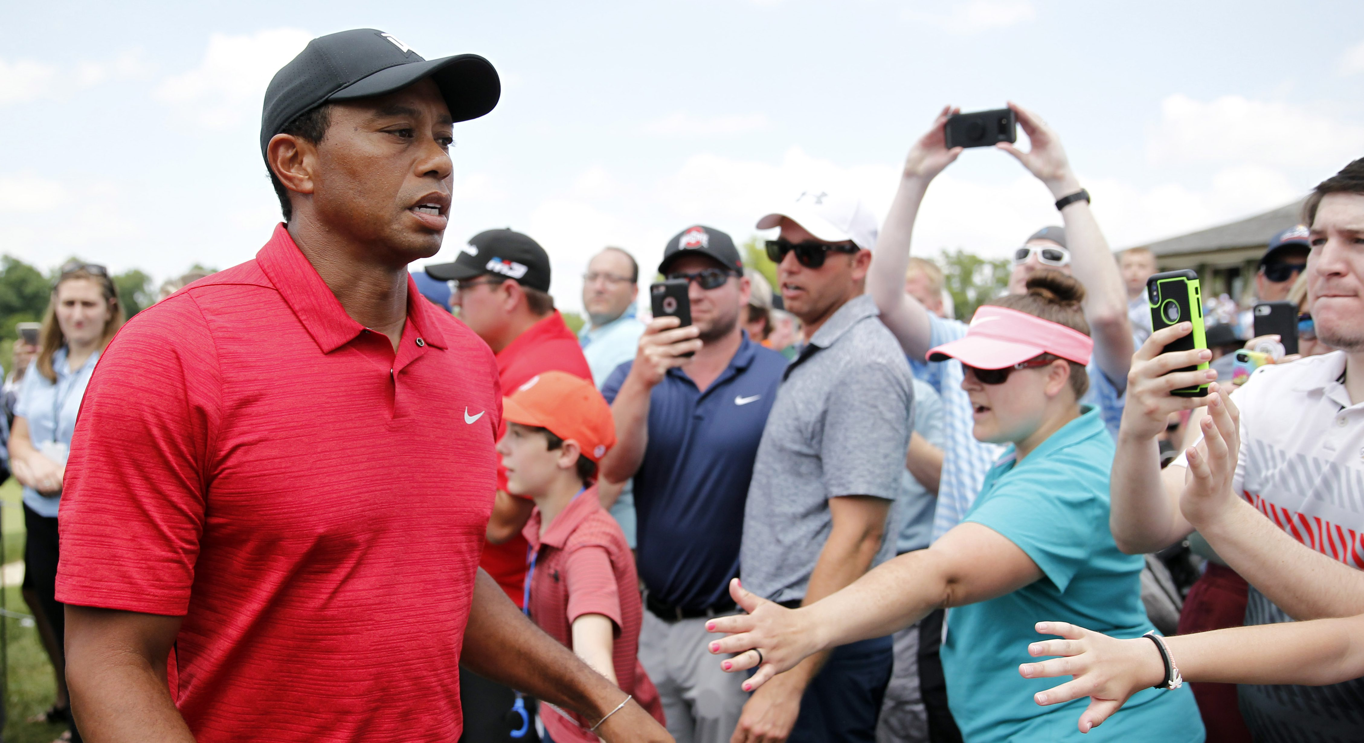 Jun 3, 2018; Dublin, OH, USA; Tiger Woods walks through the crowd after finishing the final round of The Memorial golf tournament at Muirfield Village Golf Club. Mandatory Credit: Caylor Arnold-USA TODAY Sports