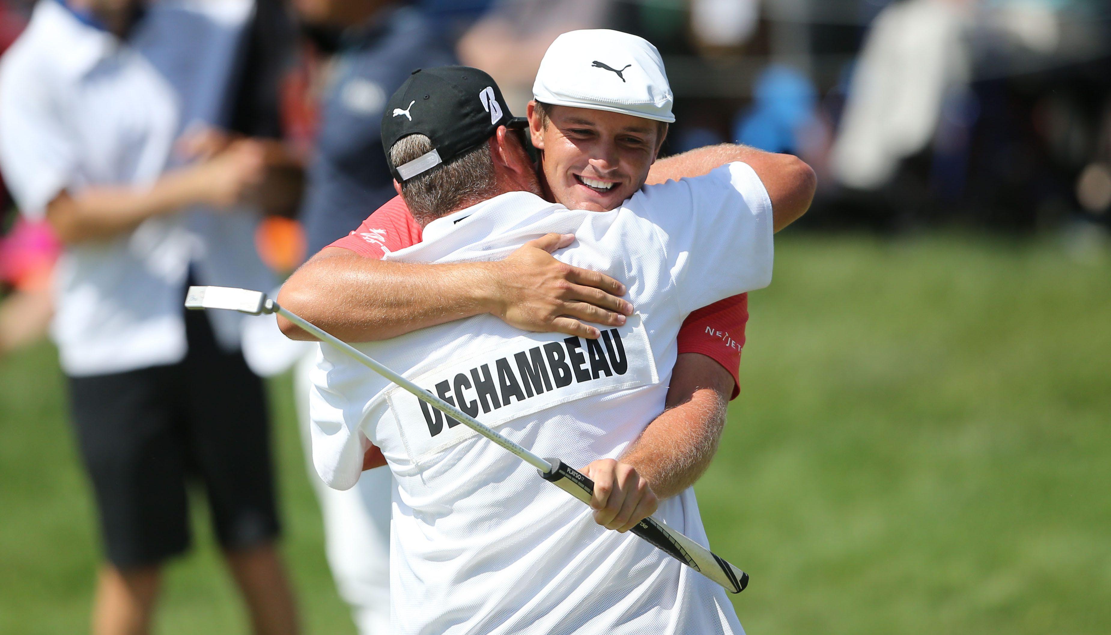 Jun 3, 2018; Dublin, OH, USA; Bryson DeChambeau celebrates with his caddie after winning The Memorial golf tournament at Muirfield Village Golf Club. Mandatory Credit: Joe Maiorana-USA TODAY Sports