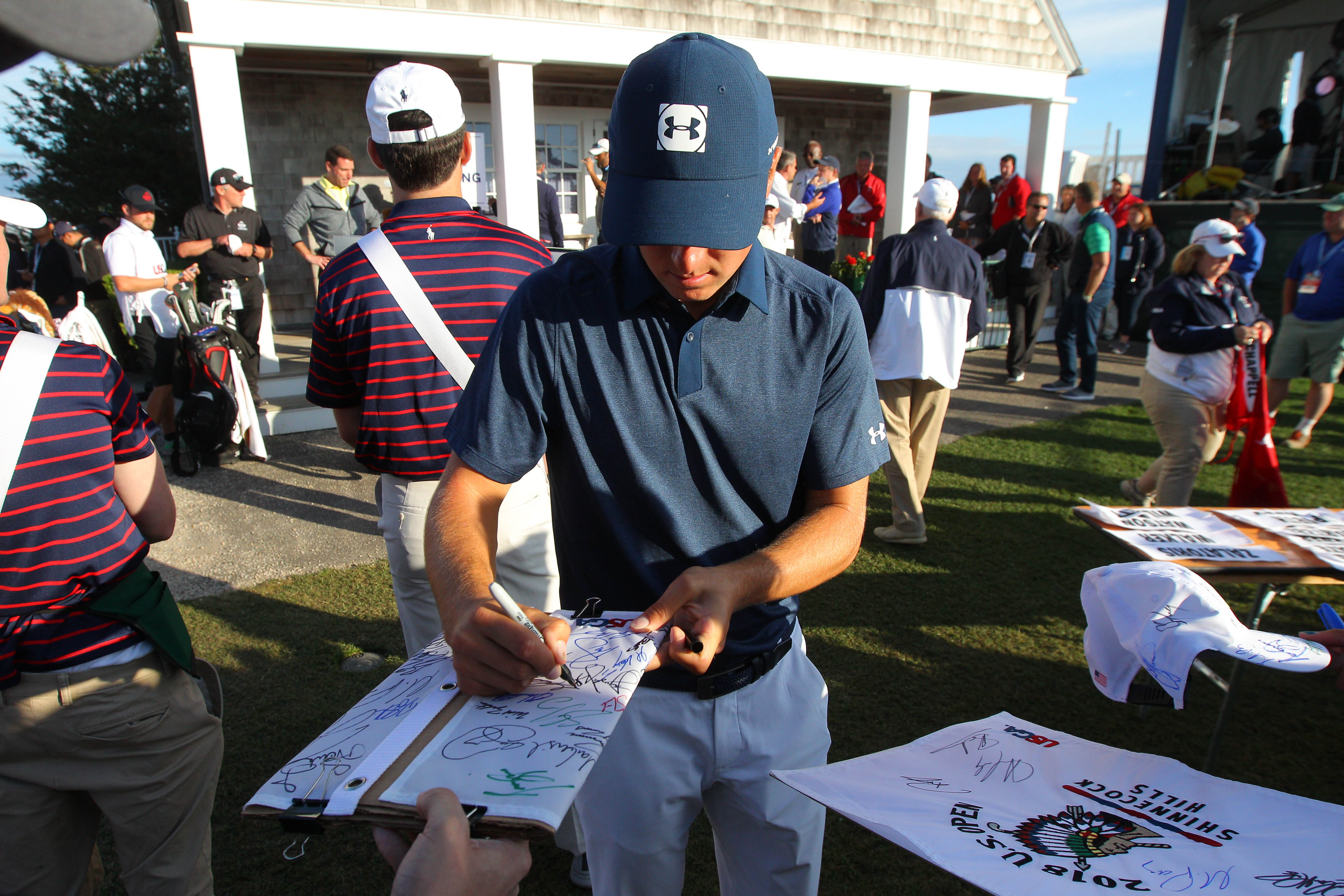Jun 15, 2018; Southampton, NY, USA; Jordan Spieth signs autographs after completing the second round of the U.S. Open golf tournament at Shinnecock Hills GC - Shinnecock Hills Golf C. Mandatory Credit: Brad Penner-USA TODAY Sports