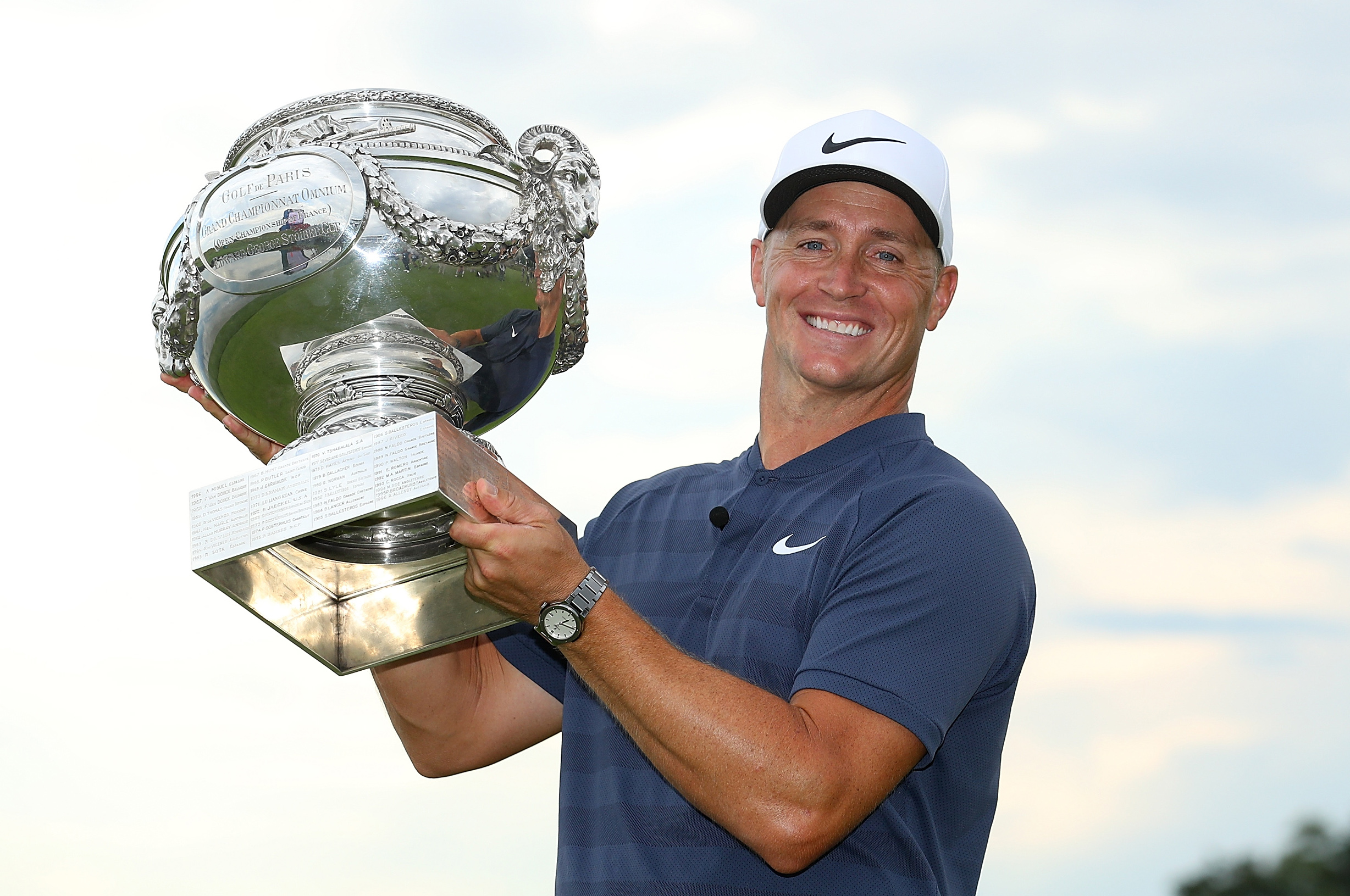 PARIS, FRANCE - JULY 01: Alex Noren of Sweden celebrates with the trophy after winning the HNA Open de France at Le Golf National on July 1, 2018 in Paris, France. (Photo by Warren Little/Getty Images)