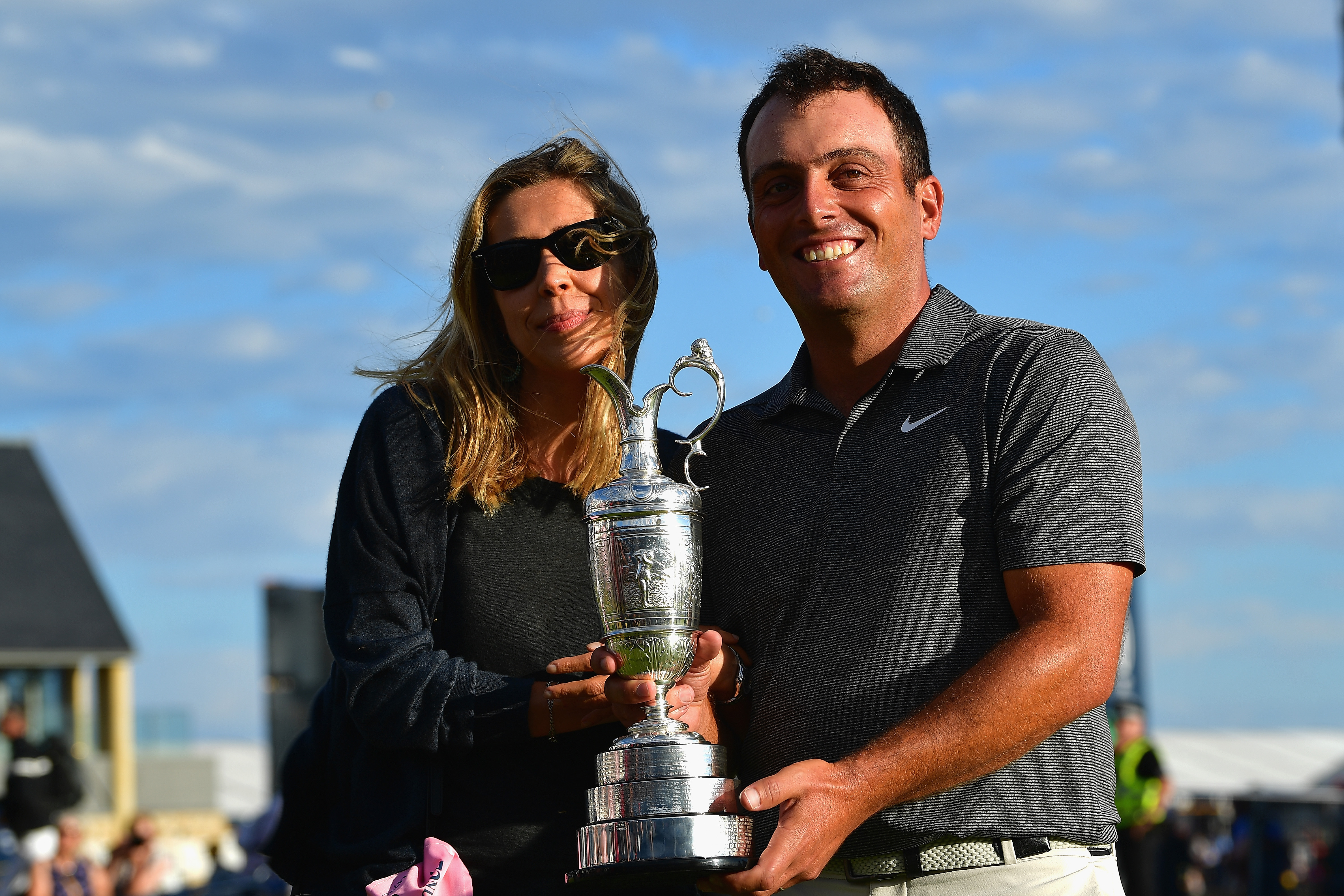 CARNOUSTIE, SCOTLAND - JULY 22:  Francesco Molinari of Italy celebrates with his wife Valentina and the Claret Jug after winning the 147th Open Championship at Carnoustie Golf Club on July 22, 2018 in Carnoustie, Scotland.  (Photo by Stuart Franklin/Getty Images)