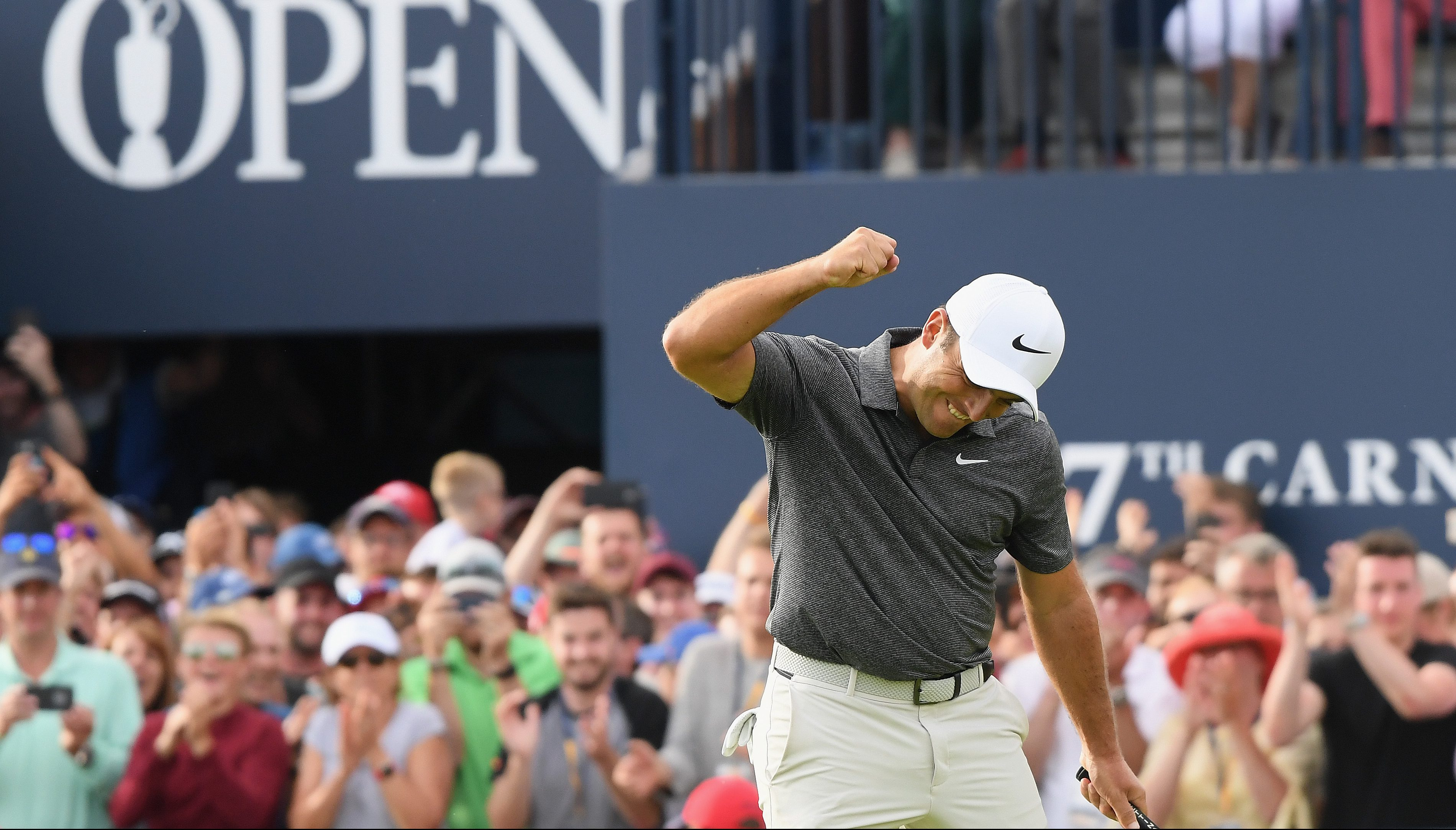 CARNOUSTIE, SCOTLAND - JULY 22: Francesco Molinari of Italy celebrates a birdie on the 18th hole during the final round of the 147th Open Championship at Carnoustie Golf Club on July 22, 2018 in Carnoustie, Scotland. (Photo by Harry How/Getty Images)