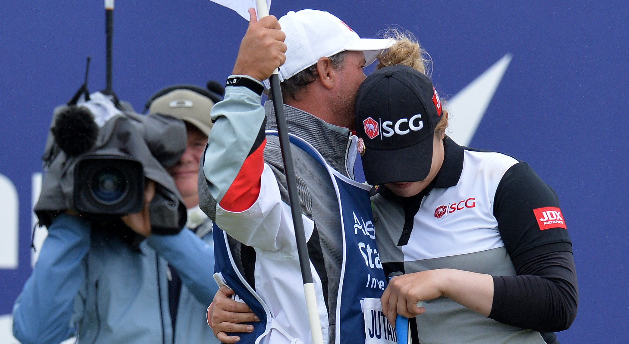 GULLANE, SCOTLAND - JULY 29: Ariya Jutanugarm of Thailand embraces her caddie after sinking her final putt at the 18th green to wins the Ladies Scottish Open during the final day of the Aberdeen Ladies Scottish Open at Gullane Golf Course on July 29, 2018 in Gullane, Scotland. (Photo by Mark Runnacles/Getty Images)