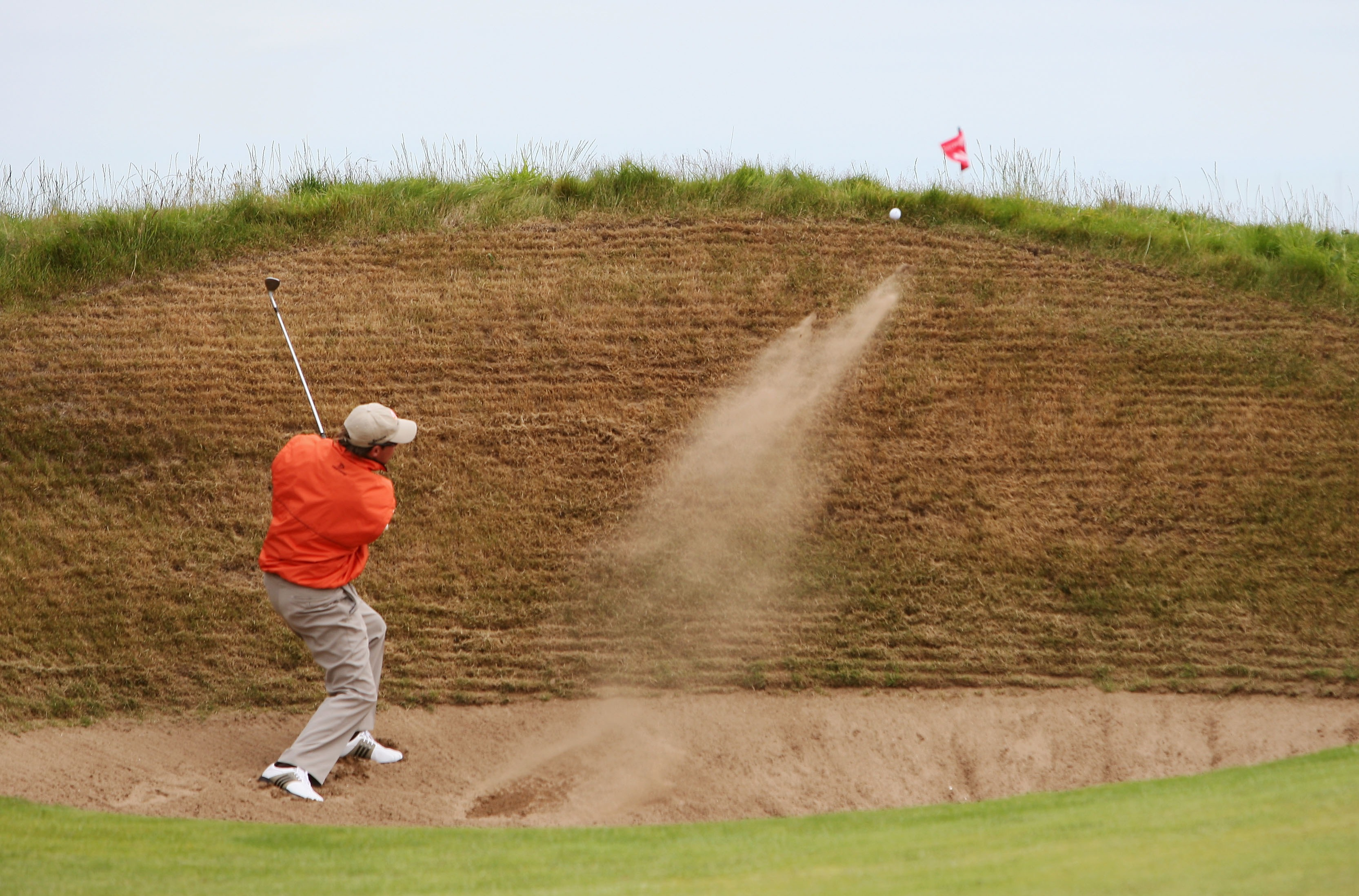 CARNOUSTIE, UNITED KINGDOM - JULY 20: Brian Davis of England plays a bunker shot on the 14th hole during the second round of The 136th Open Championship at the Carnoustie Golf Club on July 20, 2007 in Carnoustie, Scotland. (Photo by Ross Kinnaird/Getty Images)