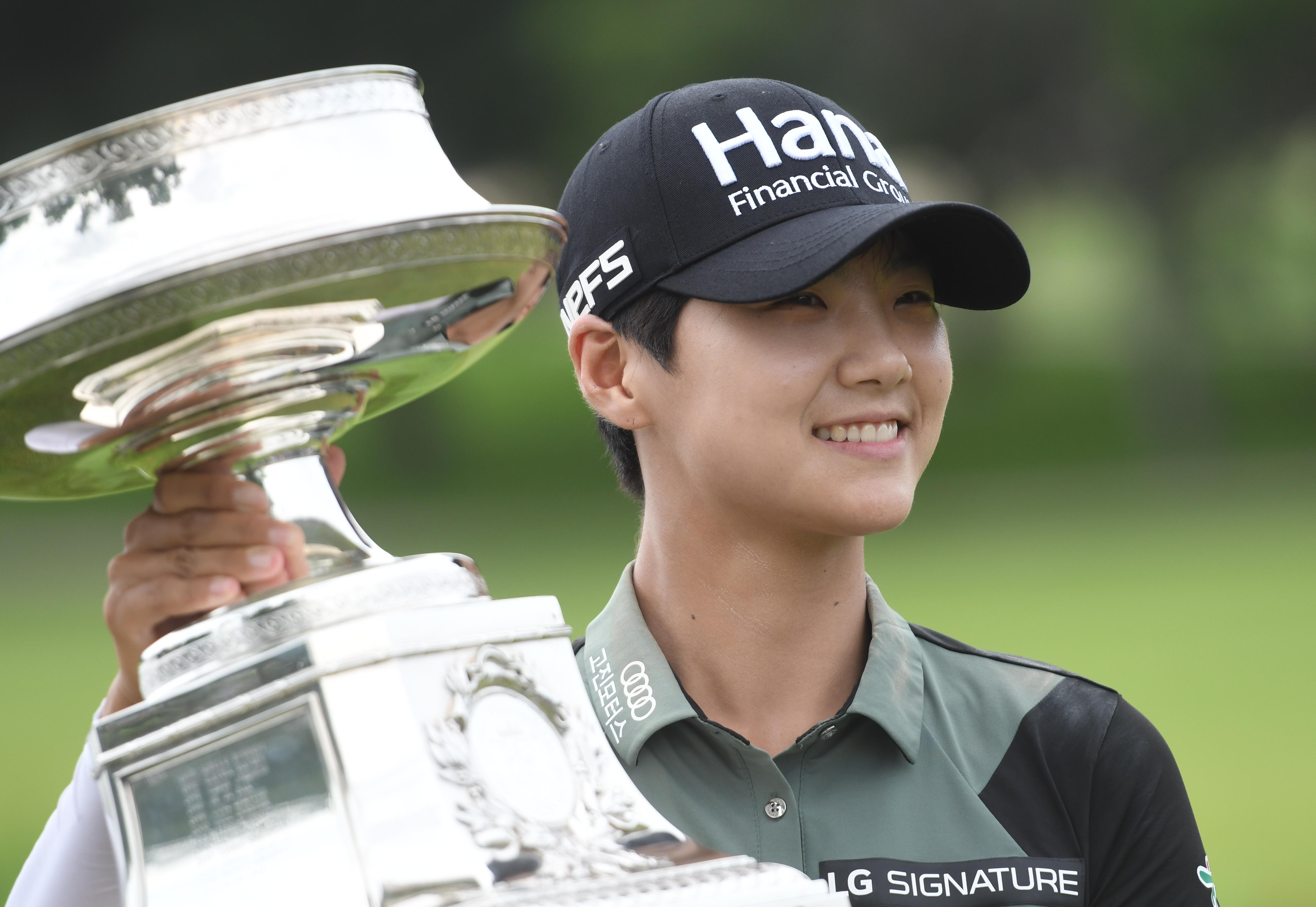 July 1, 2018; Kildeer, IL, USA; Sung Hyun Park poses with the trophy after winning the KPMG Women's PGA Championship golf tournament at Kemper Lakes Golf Club. Mandatory Credit: Thomas J. Russo-USA TODAY Sports