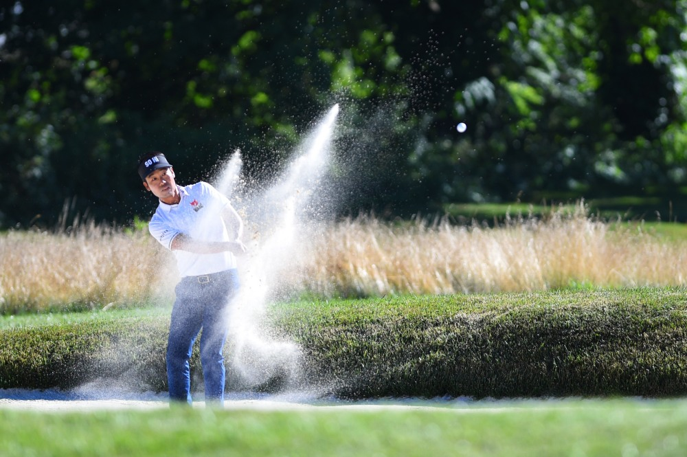 Jul 8, 2018; White Sulphur Springs, WV, USA; Kevin Na out of the sand on the 17th hole during the final round of A Military Tribute at The Greenbrier golf tournament at The Old White TPC. Mandatory Credit: Bob Donnan-USA TODAY Sports