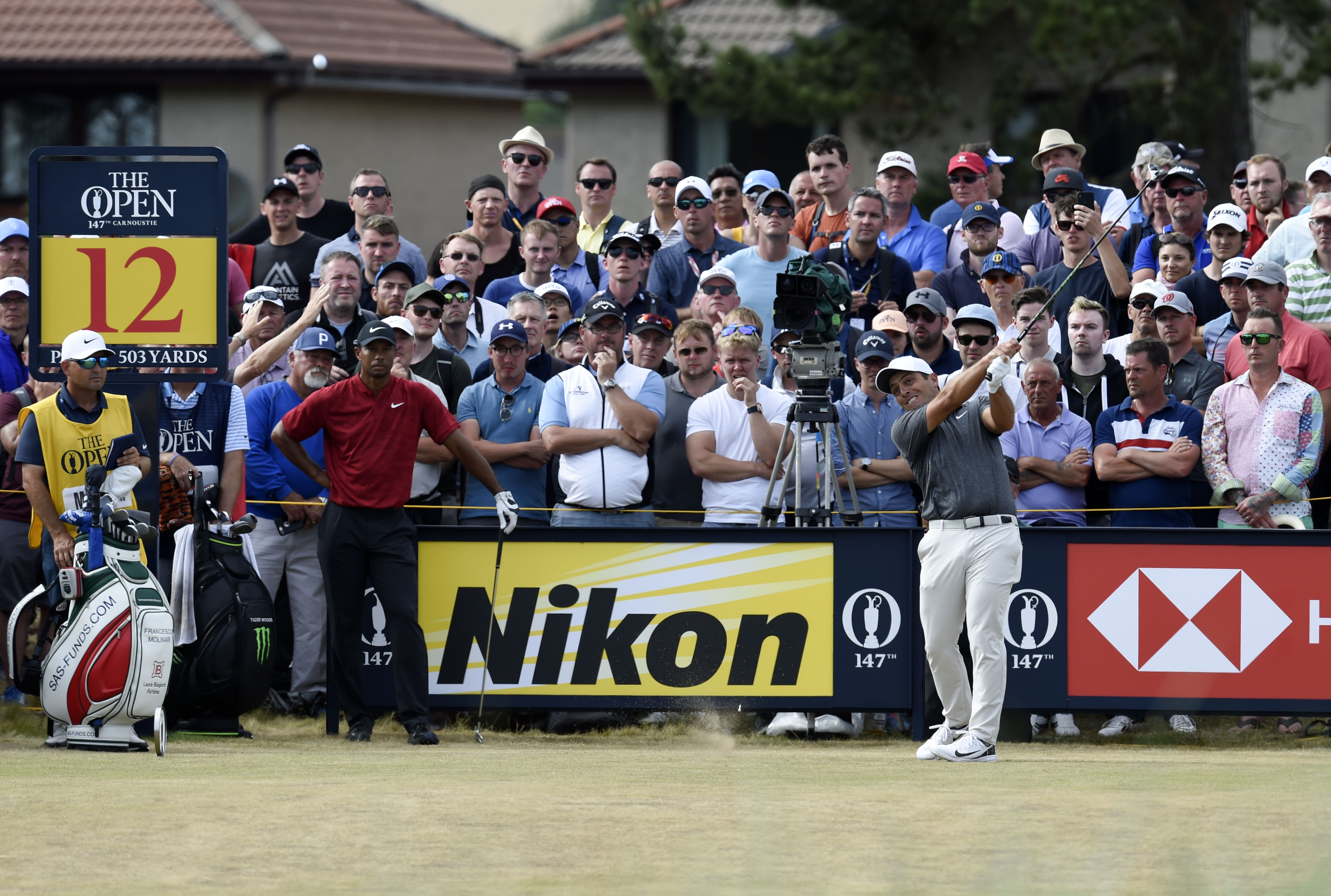 Jul 22, 2018; Carnoustie, Angus, SCT; Francesco Molinari plays a shot in front of Tiger Woods on the 12th tee during the final round of The Open Championship golf tournament at Carnoustie Golf Links. Mandatory Credit: Ian Rutherford-USA TODAY Sports
