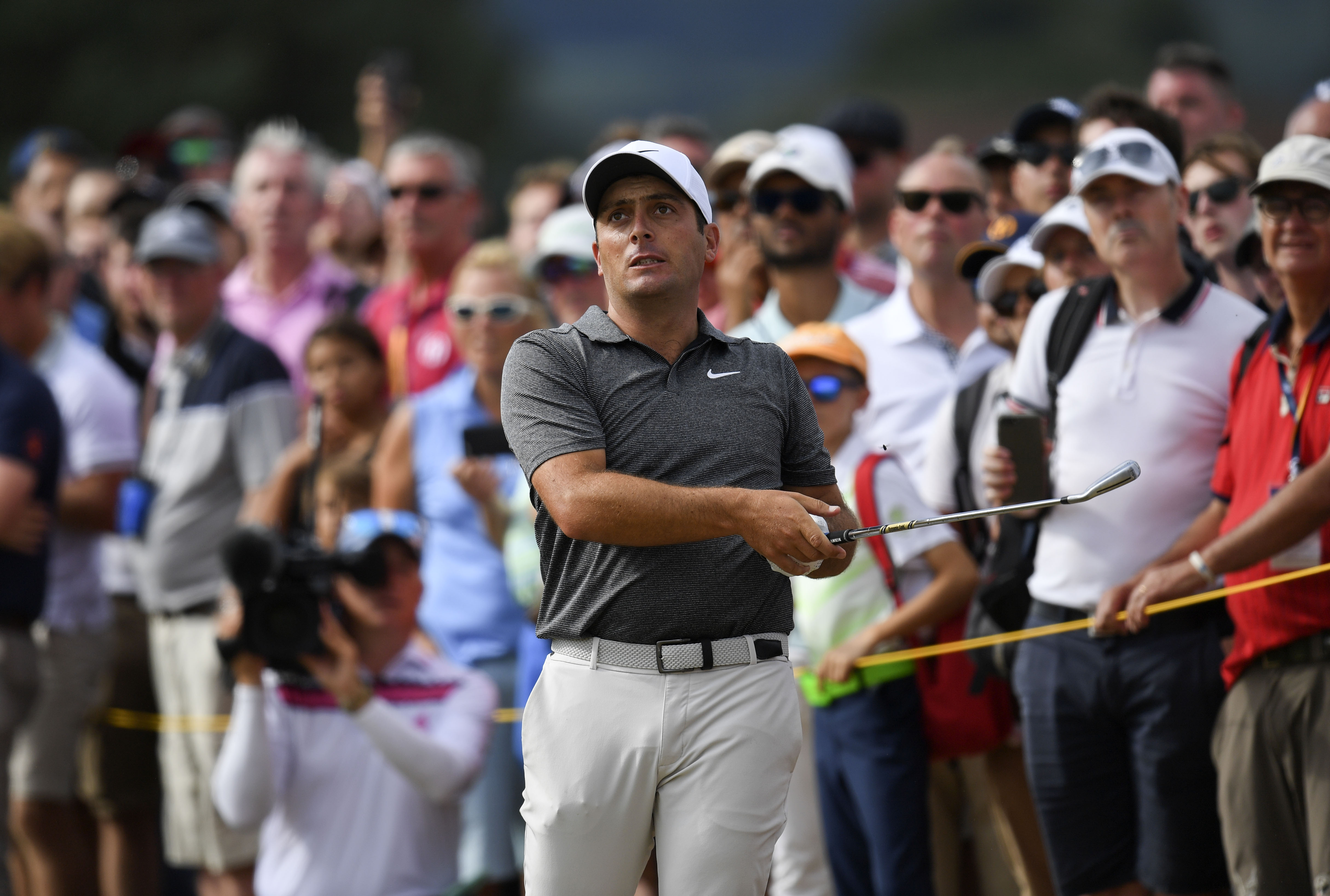 Jul 22, 2018; Carnoustie, Angus, SCT; Francesco Molinari hits in the tall grass on the 12th fairway during the final round of The Open Championship golf tournament at Carnoustie Golf Links. Mandatory Credit: Thomas J. Russo-USA TODAY Sports
