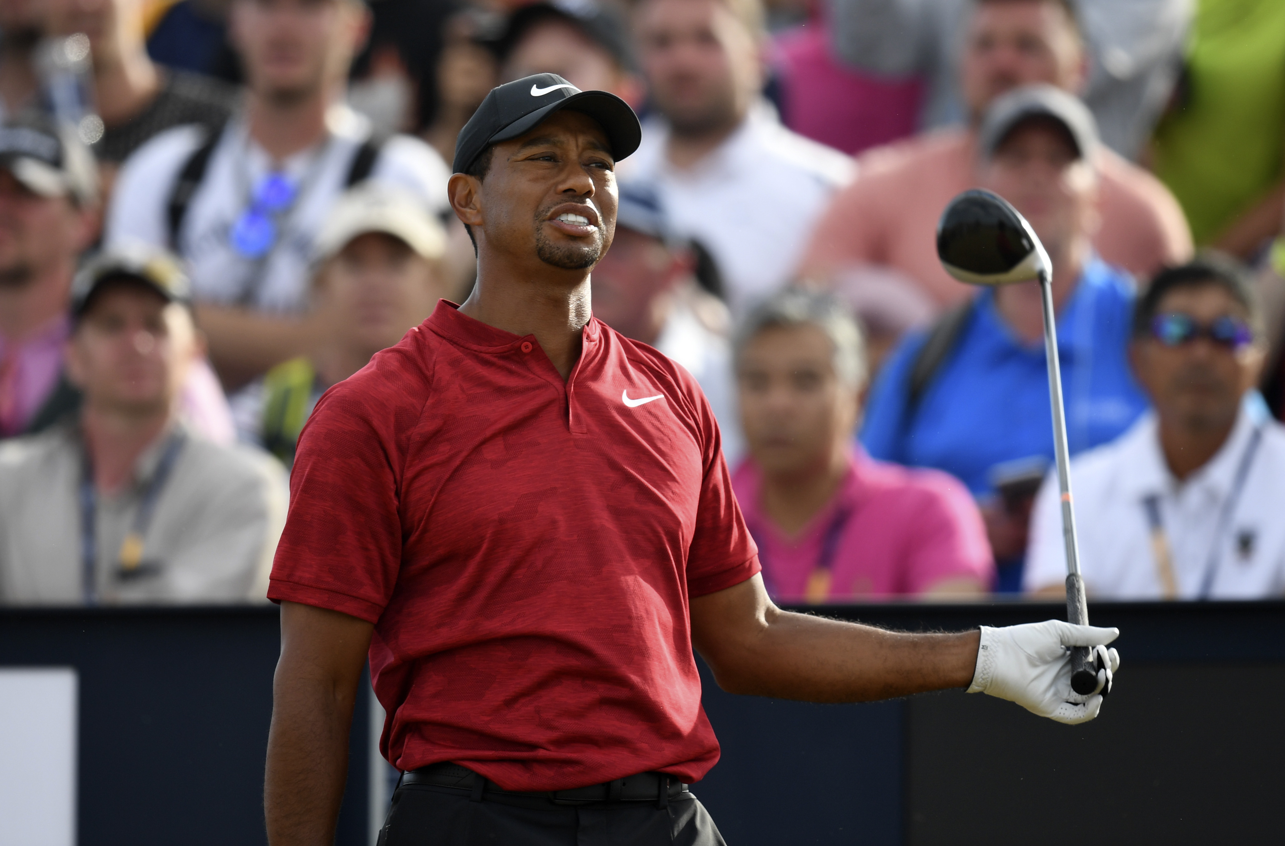 Jul 22, 2018; Carnoustie, Angus, SCT; Tiger Woods reacts to a heckler in the crowd during his swing of his tee shot on the 18th during the final round of The Open Championship golf tournament at Carnoustie Golf Links. Mandatory Credit: Thomas J. Russo-USA TODAY Sports
