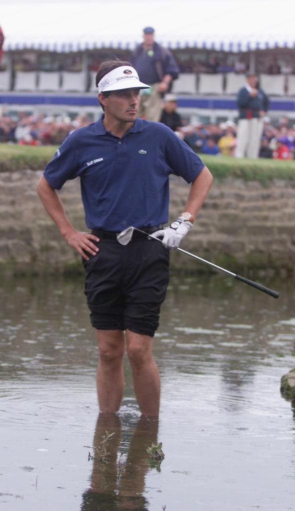 CARNOUSTIE, UNITED KINGDOM: Jean Van De Velde of France looks at the cup from deep in the burn next to the 18th green at Carnoustie 18 July 1999 during the final round of the 128th British Open Championship. Van De Velde lost his lead on the final hole and forced a 3-way play-off. (ELECTRONIC IMAGE) AFP PHOTO/Gerry PENNY (Photo credit should read GERRY PENNY/AFP/Getty Images)