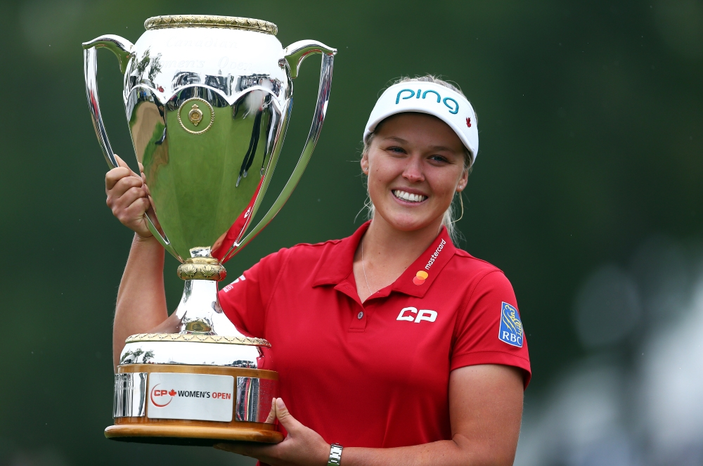 REGINA, CANADA - AUGUST 26: Brooke Henderson of Canada lifts the champions trophy following the final round of the CP Womens Open at the Wascana Country Club on August 26, 2018 in Regina, Canada. (Photo by Vaughn Ridley/Getty Images)