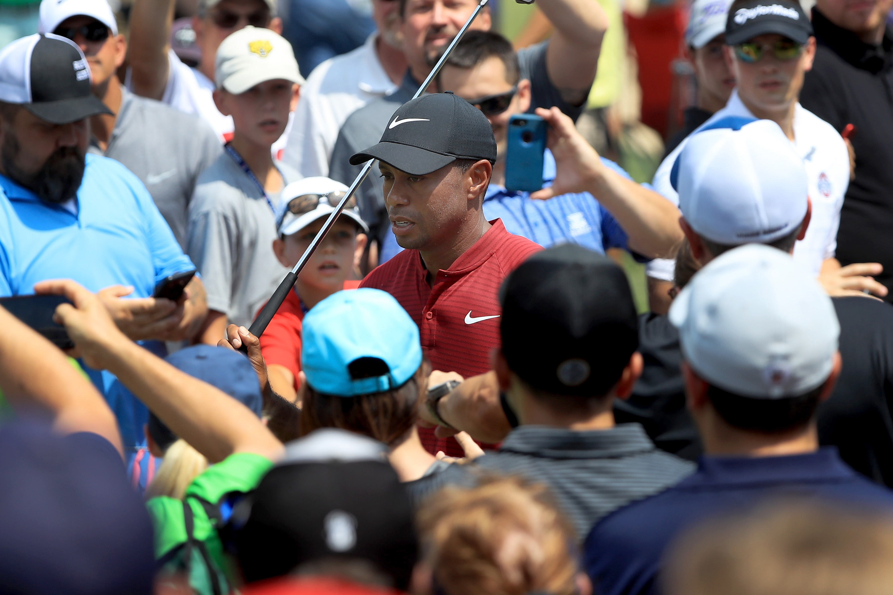 AKRON, OH - AUGUST 05: Tiger Woods walks through the crowd during the World Golf Championships-Bridgestone Invitational - Final Round at Firestone Country Club South Course on August 5, 2018 in Akron, Ohio. (Photo by Sam Greenwood/Getty Images)