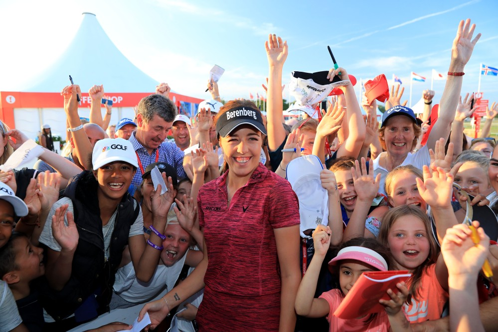 LYTHAM ST ANNES, ENGLAND - AUGUST 05: Georgia Hall of England is greeted by a large group of young children after her victory in the final round of the Ricoh Women's British Open at Royal Lytham and St Annes Golf Club on August 5, 2018 in Lytham St Annes, England. (Photo by David Cannon/Getty Images)