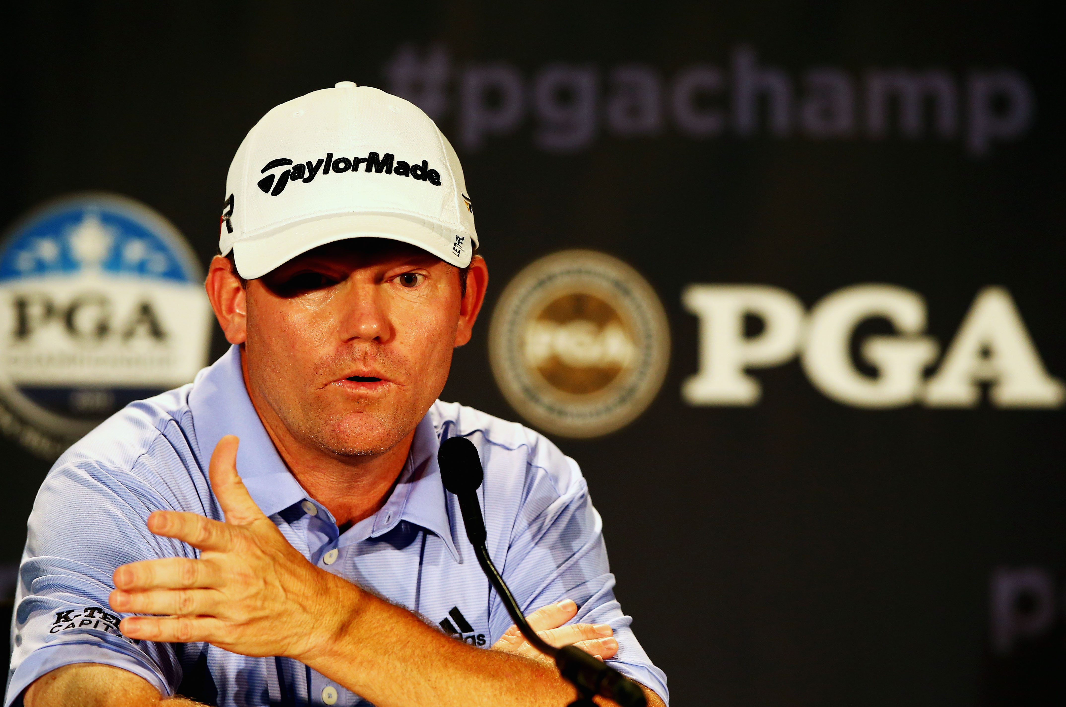 ROCHESTER, NY - AUGUST 06: Shaun Micheel of the United States is interviewed during a press conference prior to the start of the 95th PGA Championship at Oak Hill Country Club on August 6, 2013 in Rochester, New York. (Photo by Streeter Lecka/Getty Images)