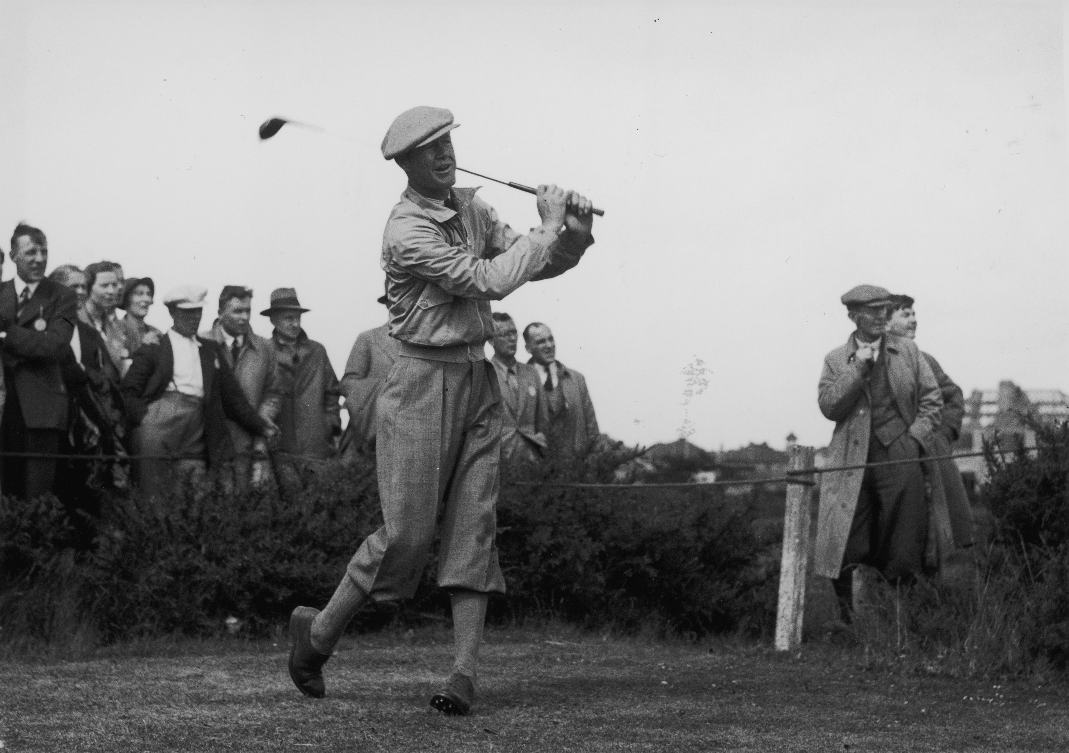30th June 1937: American golfer, Byron Nelson driving off during his match in the Ryder Cup. The USGA repetitive ball-testing machine is named 'Iron Byron' after him. He won two Masters, two USPGA and one US Open Championship before WW II intervened. (Photo by Fox Photos/Getty Images)
