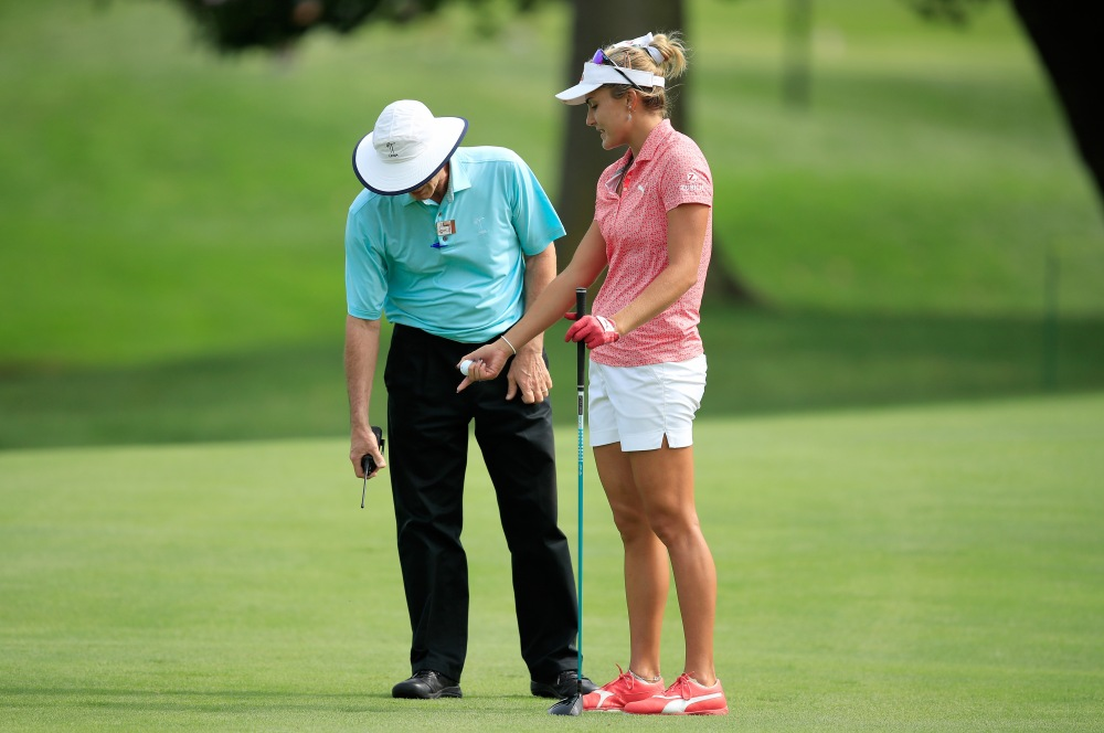 INDIANAPOLIS, IN - AUGUST 18: Lexi Thompson talks with a rules official regarding a ball placement while playing the 10th hole where she was preparing to hit her second shot from the 6th fairway during the third round of the Indy Women In Tech Championship Driven by Group 1001 at the Brickyard Crossing Golf Club on August 18, 2018 in Indianapolis, Indiana. (Photo by Andy Lyons/Getty Images)
