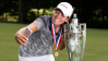 Kristen Gillman celebrates with the Robert Cox Trophy after winning the U.S. Women's Amateur. (Steven Gibbons/USGA)
