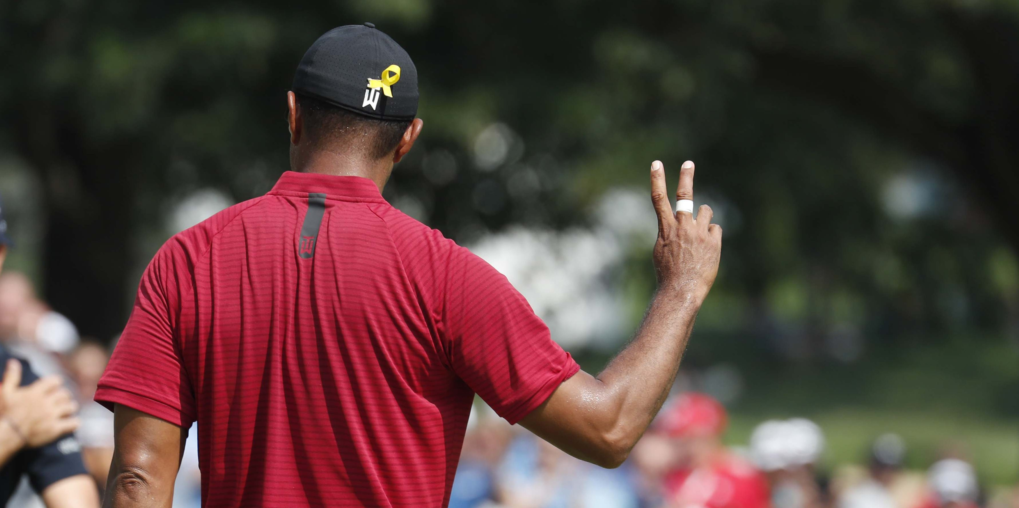 Aug 5, 2018; Akron, OH, USA; PGA golfer Tiger Woods reacts to making a birdie on the first hole during the final round of the WGC - Bridgestone Invitational golf tournament at Firestone Country Club - South Course. Mandatory Credit: Brian Spurlock-USA TODAY Sports