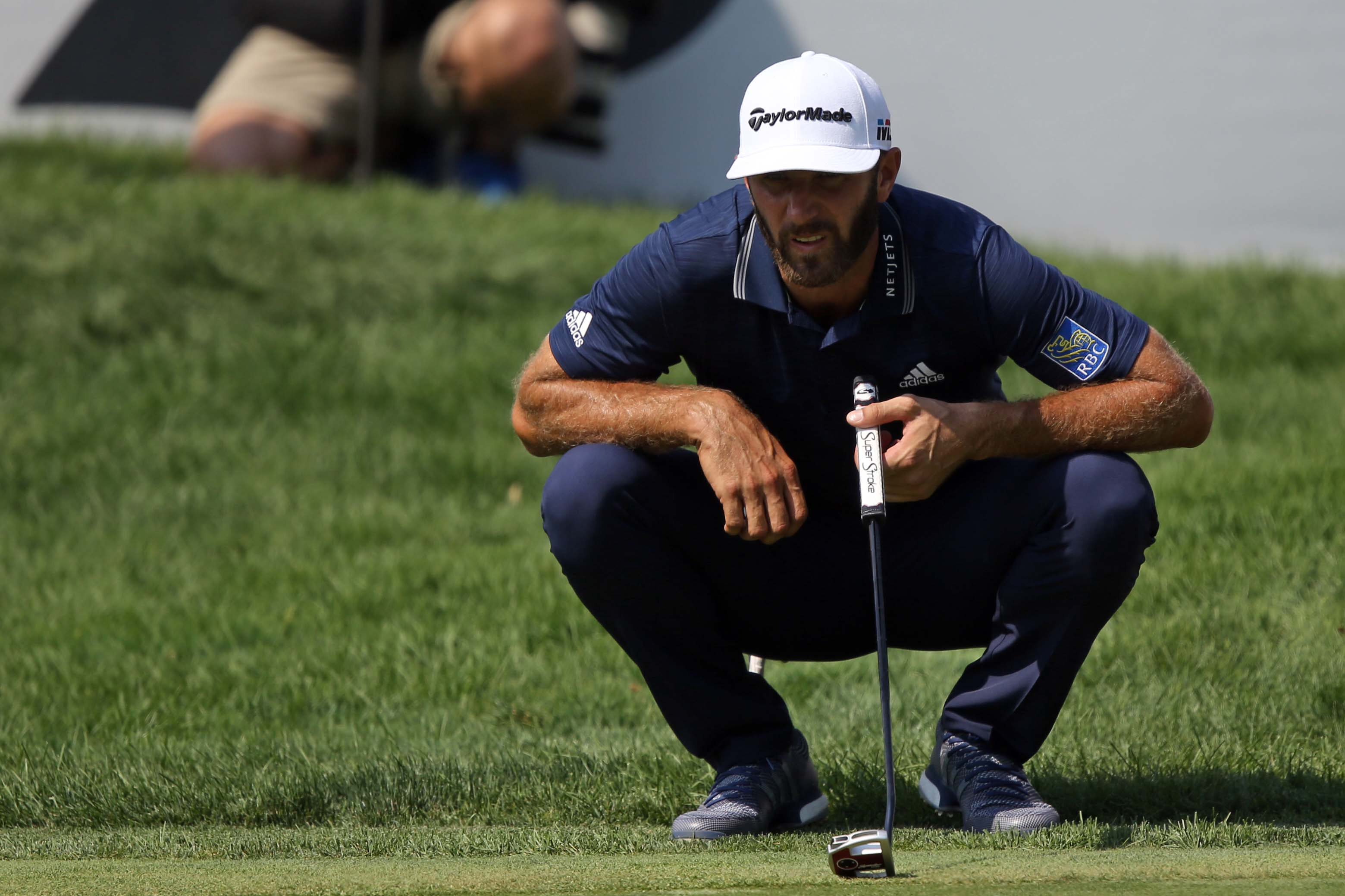 Aug 5, 2018; Akron, OH, USA; Dustin Johnson lines up a putt on the 18th green during the final round of the WGC - Bridgestone Invitational golf tournament at Firestone Country Club - South Course. Mandatory Credit: Aaron Doster-USA TODAY Sports