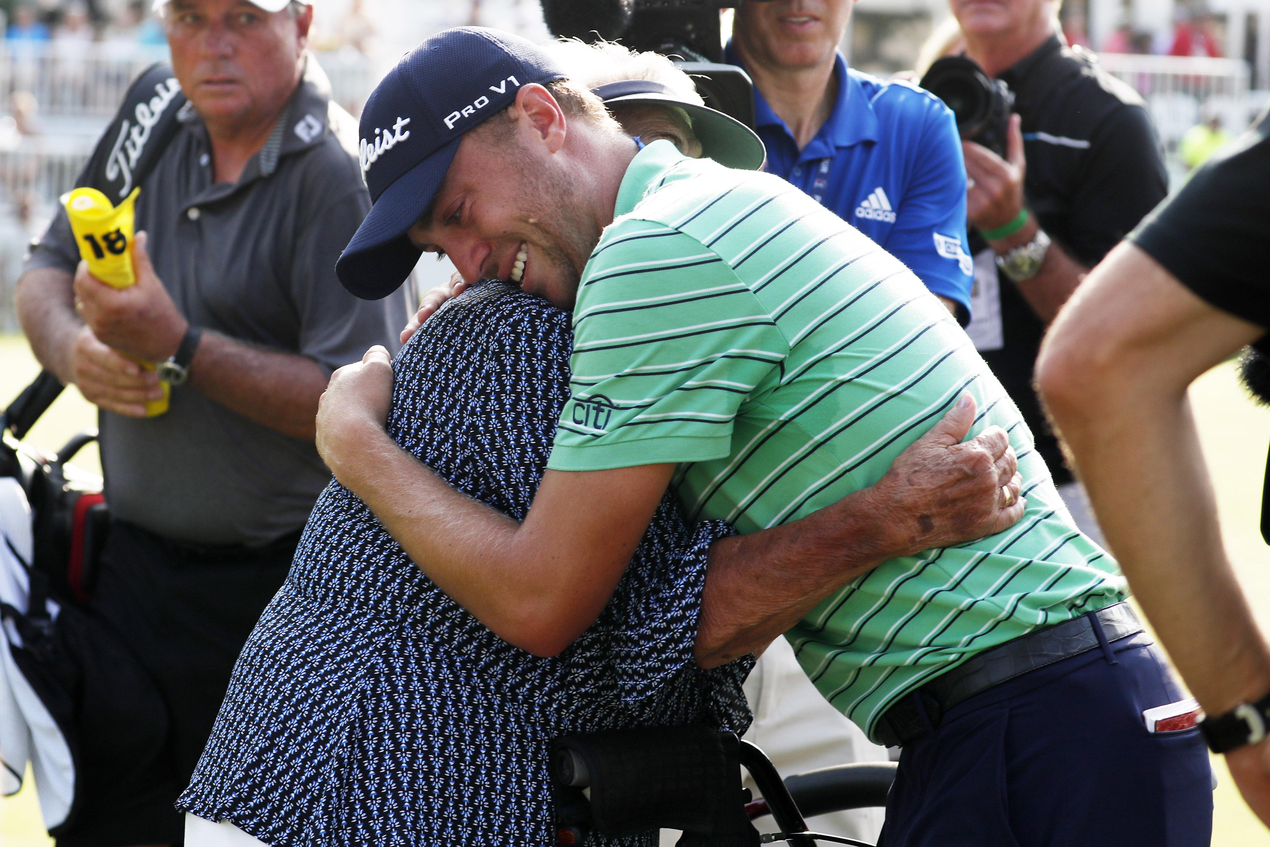 Aug 5, 2018; Akron, OH, USA; PGA golfer Justin Thomas hugs his grandmother after winning the WGC - Bridgestone Invitational golf tournament at Firestone Country Club - South Course. Mandatory Credit: Brian Spurlock-USA TODAY Sports