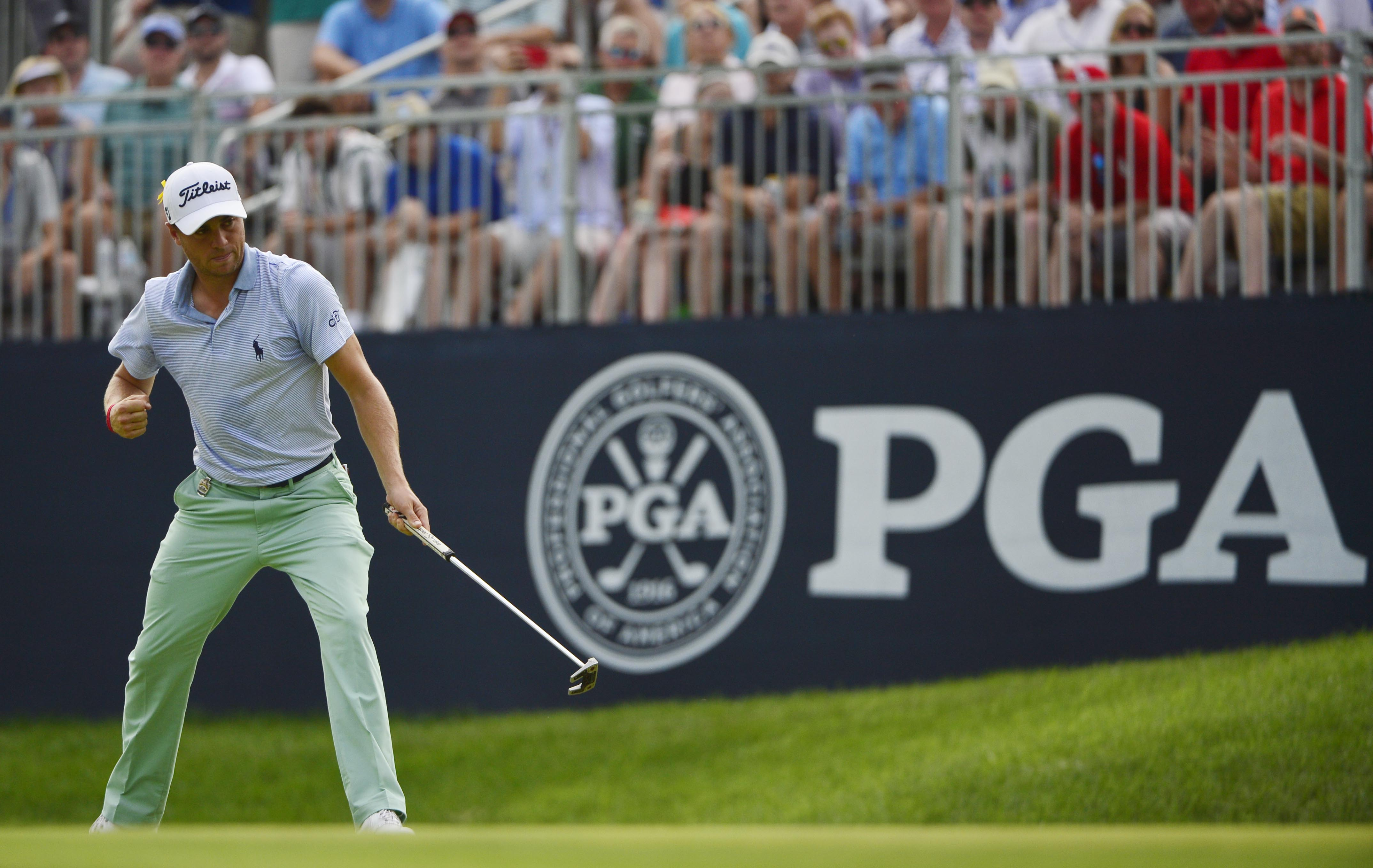 Aug 12, 2018; Saint Louis, MO, USA; Justin Thomas pumps his fist after making a birdie putt on the 10th green during the final round of the PGA Championship golf tournament at Bellerive Country Club. Mandatory Credit: Jeff Curry-USA TODAY Sports