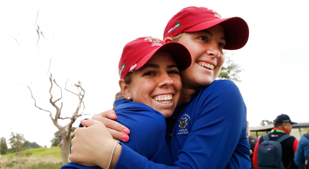 United States of America team members Kristen Gillman, (left), and Jennifer Kupcho embrace at the 18th green, during the third round of stroke play at the 2018 Women's World Amateur Team at Carton House Golf Club in Dublin, Ireland on Friday, Aug. 31, 2018. (Copyright USGA/Steven Gibbons)