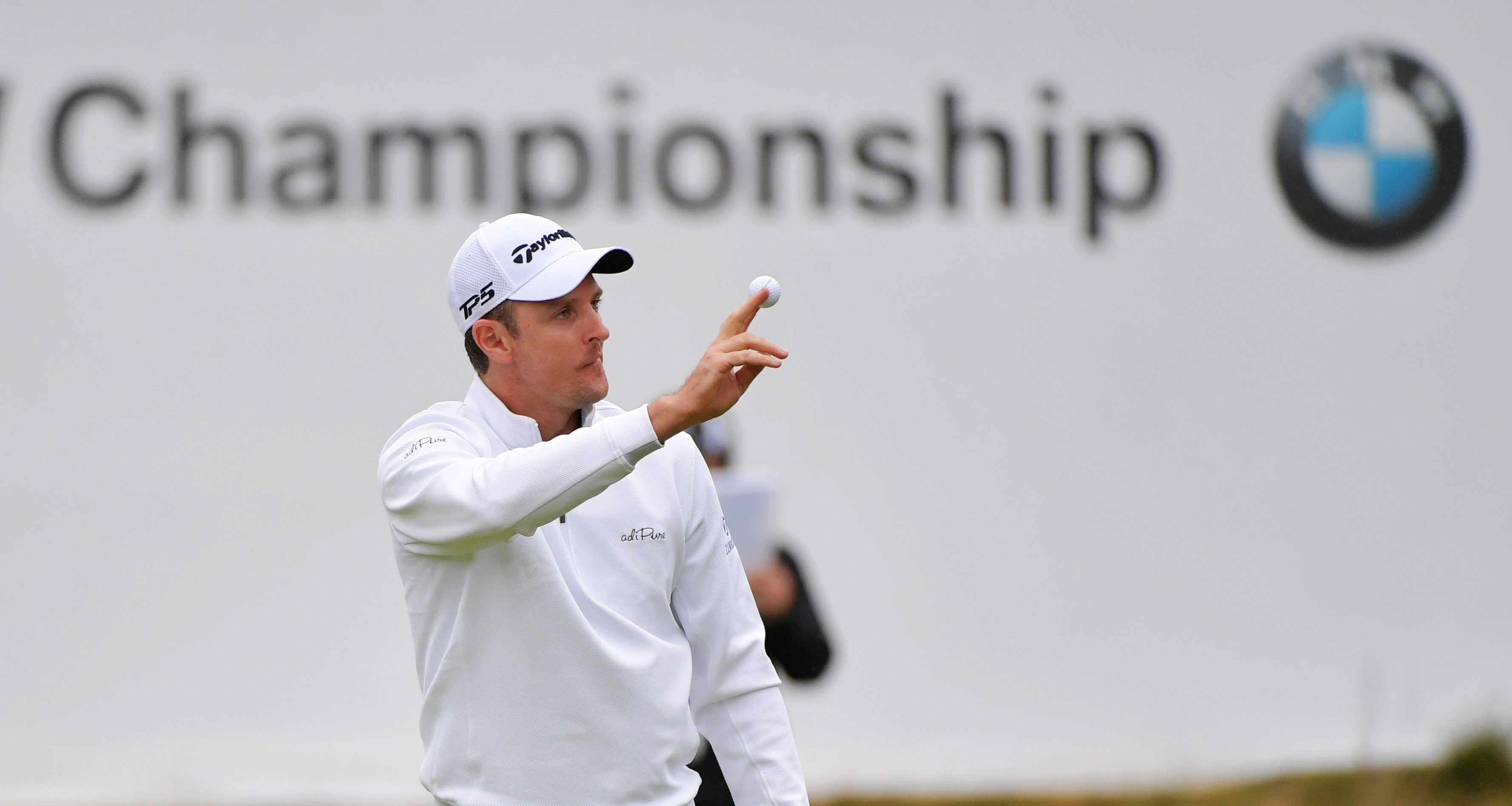NEWTOWN SQUARE, PA - SEPTEMBER 10: Justin Rose of England waves his ball to the crowd on the 17th green during the weather delayed final round of the BMW Championship at Aronimink Golf Club on September 10, 2018 in Newtown Square, Pennsylvania. (Photo by Drew Hallowell/Getty Images)