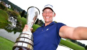 EVIAN-LES-BAINS, FRANCE - SEPTEMBER 16: Angela Stanford of the United States poses as if she was taking a selfie photograh with the Evian Championship Trophy after victory in the compeition during Day Four of The Evian Championship 2018 at Evian Resort Golf Club on September 16, 2018 in Evian-les-Bains, France. (Photo by Stuart Franklin/Getty Images)