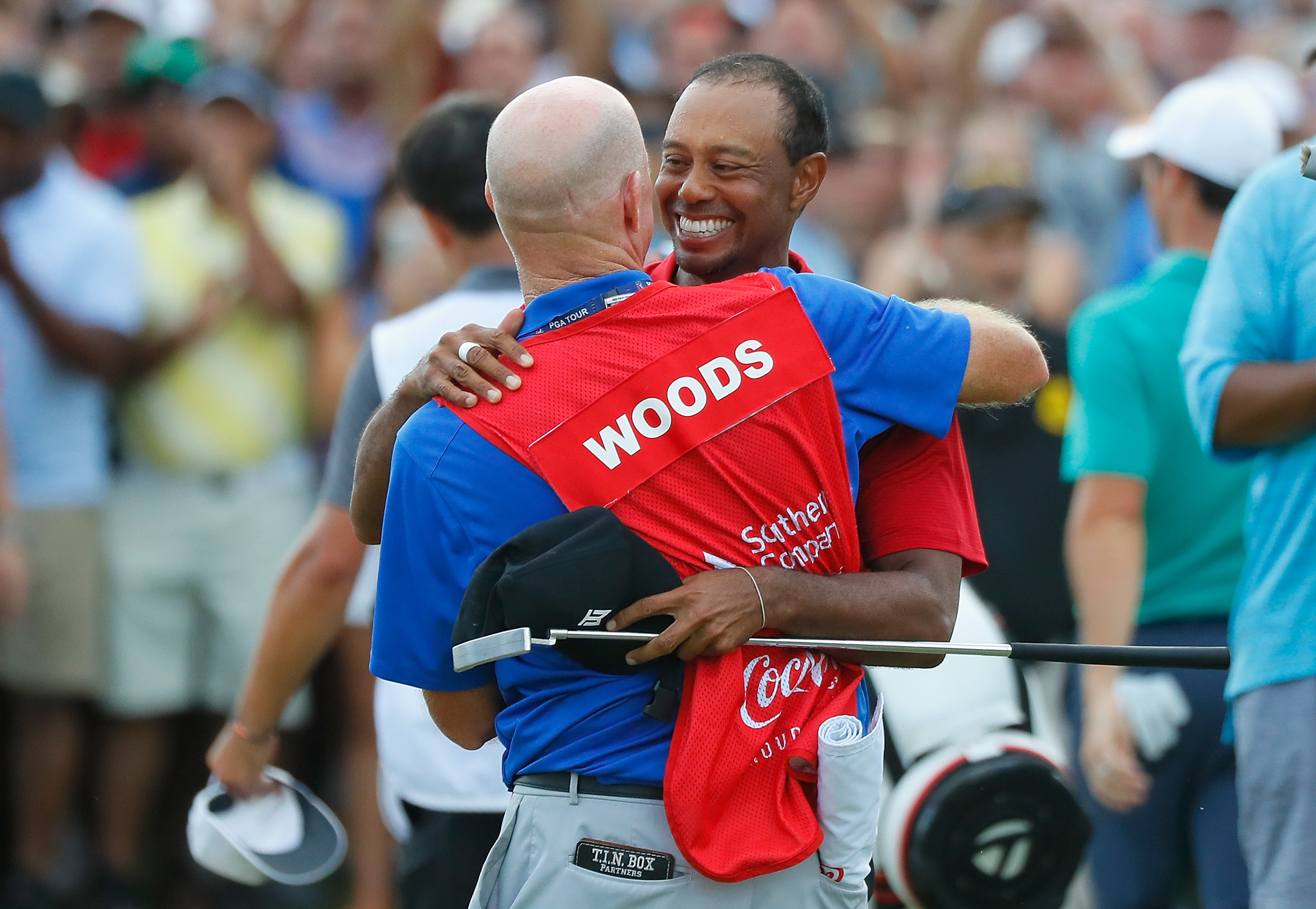 ATLANTA, GA - SEPTEMBER 23: Tiger Woods of the United States celebrates with caddie Joe LaCava after making a par on the 18th green to win the TOUR Championship at East Lake Golf Club on September 23, 2018 in Atlanta, Georgia. (Photo by Kevin C. Cox/Getty Images)