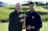 PARIS, FRANCE - SEPTEMBER 26: Jim Furyk the United States team Captain holds the Ryder Cup with Bubba Watson during the official United States team photocall ahead of the 2018 Ryder Cup at Le Golf National on September 26, 2018 in Paris, France. (Photo by David Cannon/Getty Images)