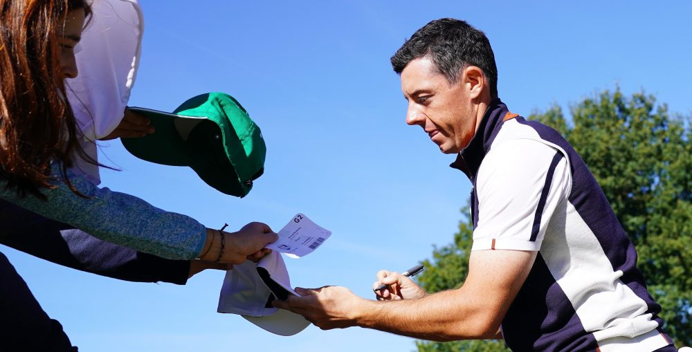 PARIS, FRANCE - SEPTEMBER 26: Rory McIlroy of Europe signs autographs during practice ahead of the 2018 Ryder Cup at Le Golf National on September 26, 2018 in Paris, France. (Photo by Stuart Franklin/Getty Images)