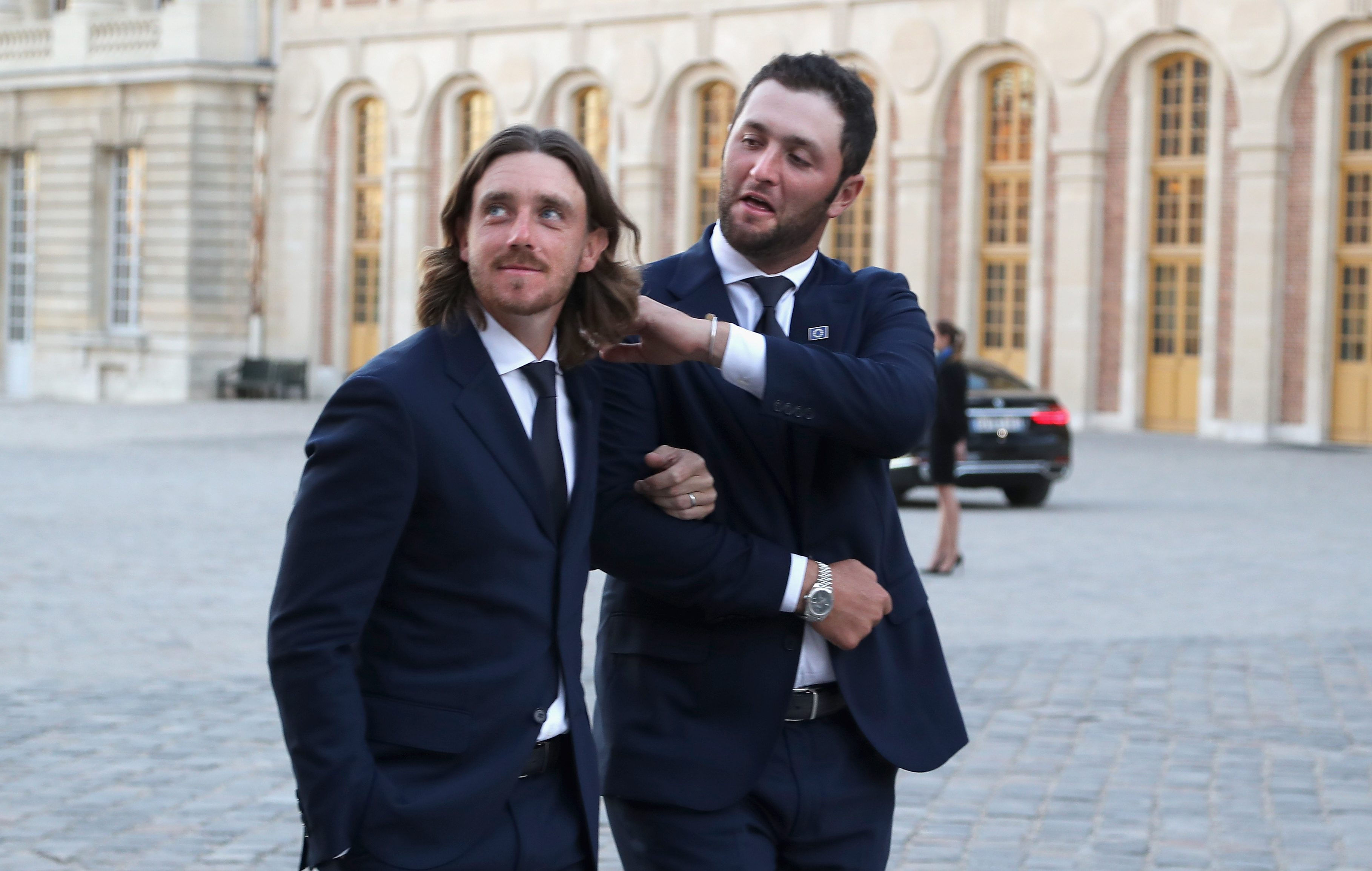 VERSAILLES, FRANCE - SEPTEMBER 26: Tommy Fleetwood and Jon Rahm of Team Europe walk in arm and arm to the Palace of Versailles for the Ryder Cup Gala dinner ahead of the 2018 Ryder Cup on September 26, 2018 in Versailles, France. (Photo by Richard Heathcote/Getty Images)
