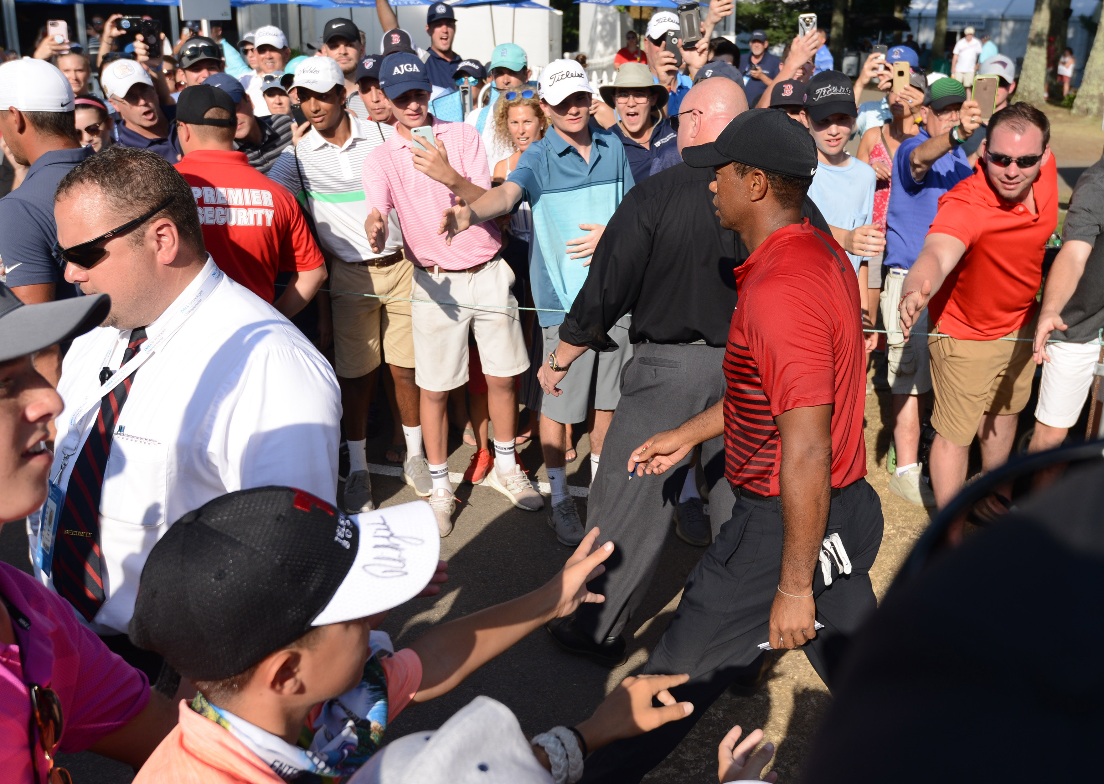 Sep 3, 2018; Norton, MA, USA; Tiger Woods walks through a large gallery after completing his final round of the Dell Technologies Championship golf tournament at TPC of Boston. Mandatory Credit: Mark Konezny-USA TODAY Sports
