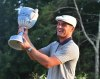 Sep 3, 2018; Norton, MA, USA; Bryson DeChambeau raises the Dell Technologies Championship trophy after winning the FedEx Cup tournament at TPC of Boston. Mandatory Credit: Mark Konezny-USA TODAY Sports