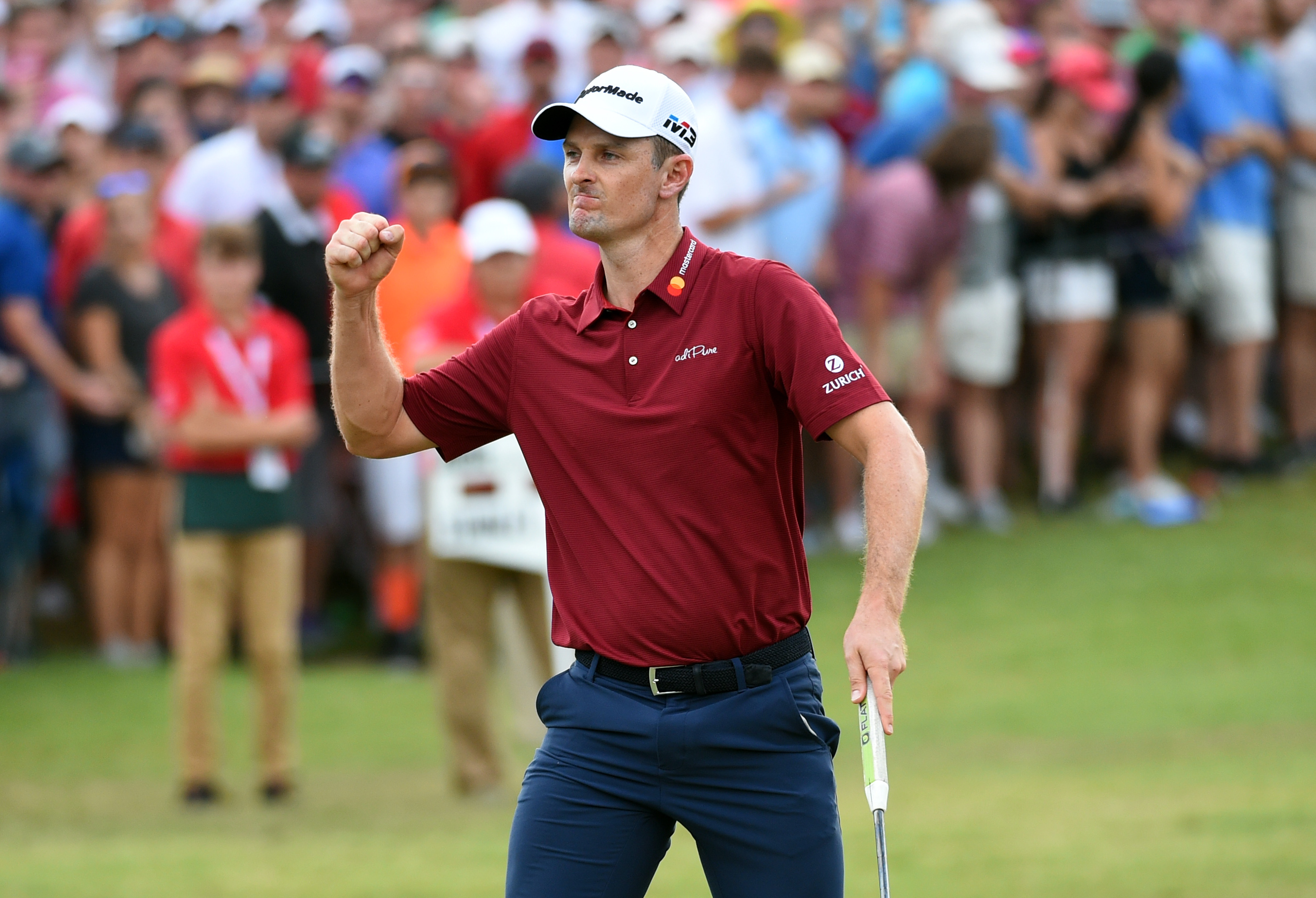 Sep 23, 2018; Atlanta, GA, USA; Justin Rose reacts when he is one putt away from winning the FedEx Cup during the final round of the Tour Championship golf tournament at East Lake Golf Club. Mandatory Credit: John David Mercer-USA TODAY Sports