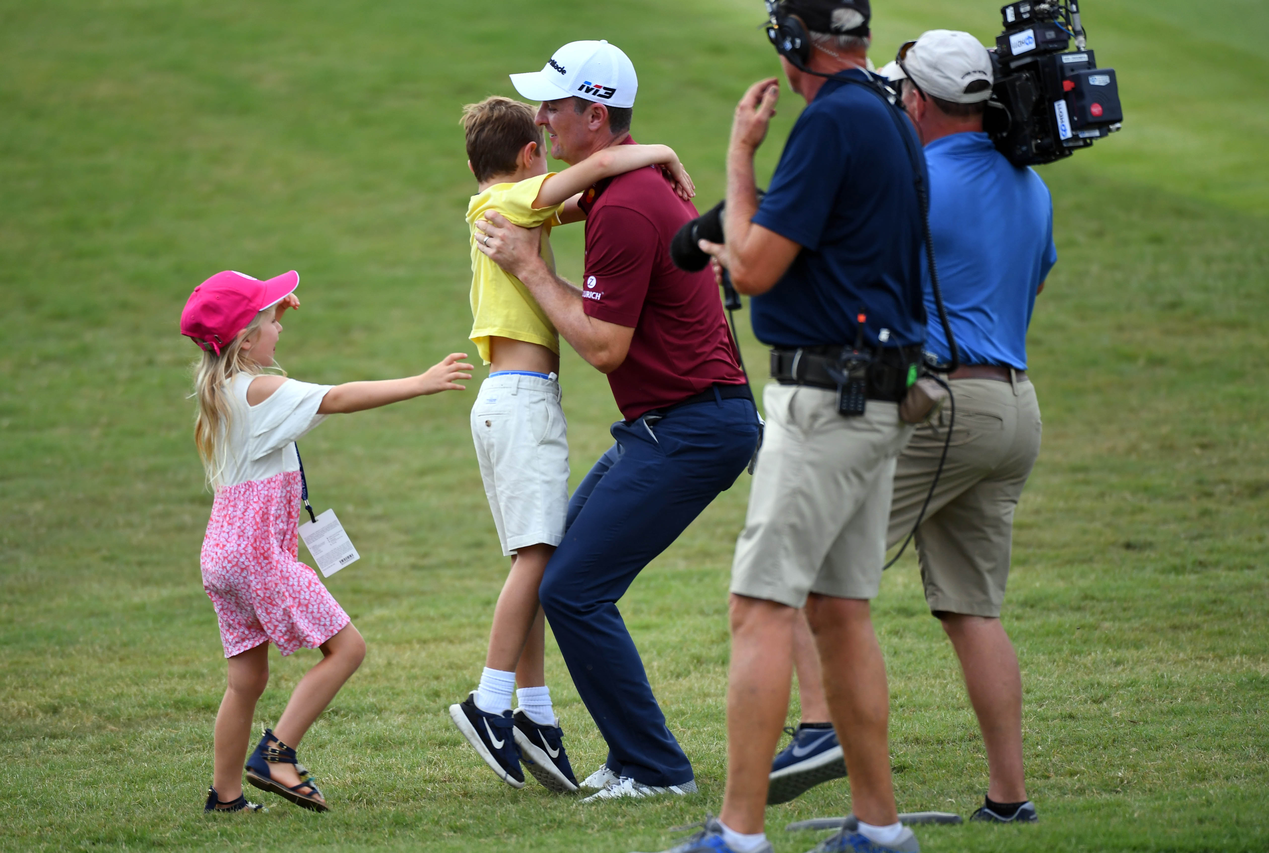 Sep 23, 2018; Atlanta, GA, USA; Justin Rose celebrates with his family after he won the FedEx Cup at the Tour Championship golf tournament at East Lake Golf Club. Mandatory Credit: Christopher Hanewinckel-USA TODAY Sports