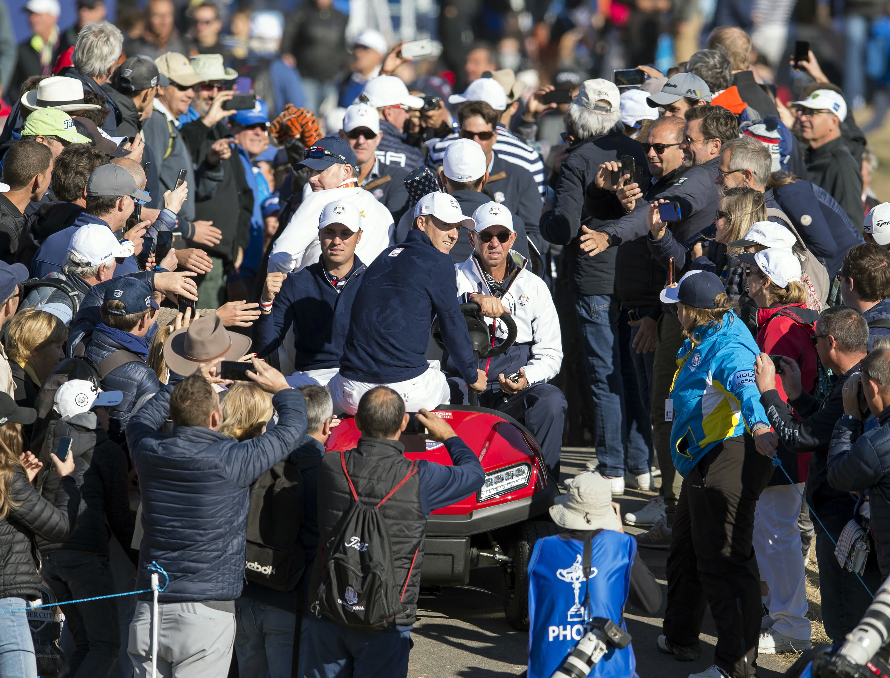 Sep 26, 2018; Paris, FRA; Jordan Spieth and Justin Thomas make their way by buggy to the 10th tee during a Ryder Cup practice round at Le Golf National. Mandatory Credit: Ian Rutherford-USA TODAY Sports
