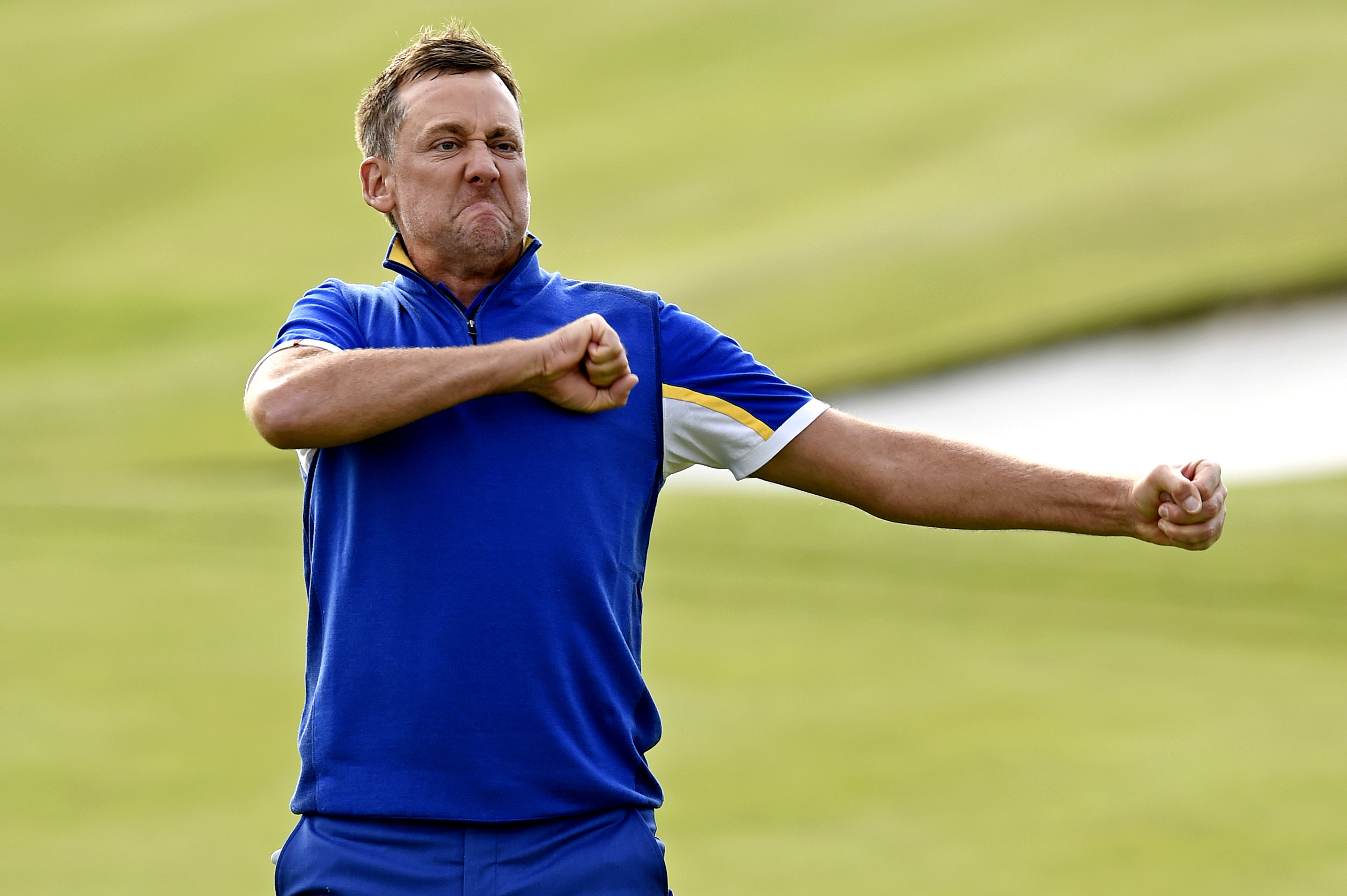 Sep 30, 2018; Paris, FRA; Europe golfer Ian Poulter celebrates on the 18th green during the Ryder Cup Sunday singles matches at Le Golf National. Mandatory Credit: Ian Rutherford-USA TODAY Sports