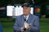 Johnny Miller stands on the 18th green of the Silverado Resort North Course during the trophy presentation of the Safeway Open PGA golf tournament Sunday, Oct. 16, 2016, in Napa, Calif. (AP Photo/Eric Risberg)