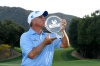 THOUSAND OAKS, CA - OCTOBER 28:  Scott Parel kisses the winner's trophy after winning the PGA Champions Tour 2018 Invesco QQQ Championship at the Sherwood Country Club on October 28, 2018 in Thousand Oaks, California. (Photo by Robert Laberge/Getty Images)