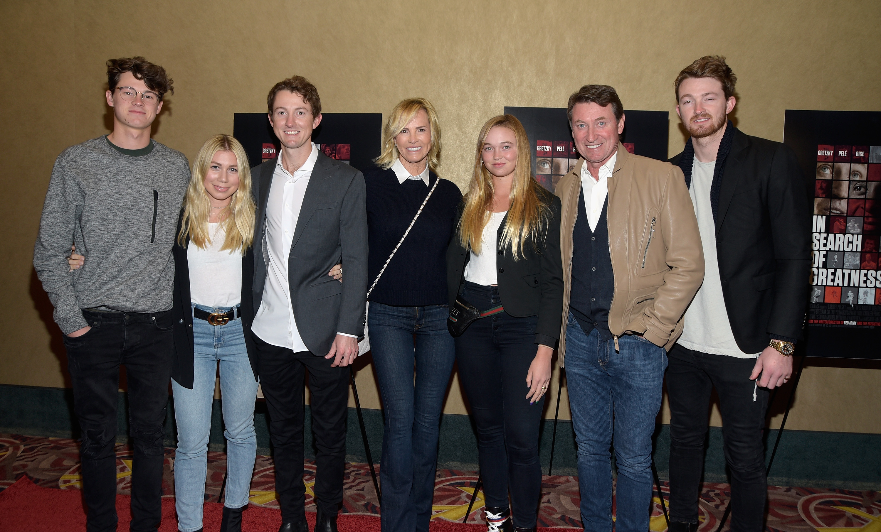"""CENTURY CITY, CA - NOVEMBER 01: (L - R) Tristan Gretsky, guest, Ty Gretzky, actress Janet Jones, Emma Gretzky, NHL legend Wayne Gretzky and Trevor Gretzky attend the Los Angeles premiere of """"In Search Of Greatness"""" released by IMG Films, AOS Art Of Sport and Moviepass Films at AMC Century City 15 theater on November 1, 2018 in Century City, California. (Photo by Michael Tullberg/Getty Images)"""