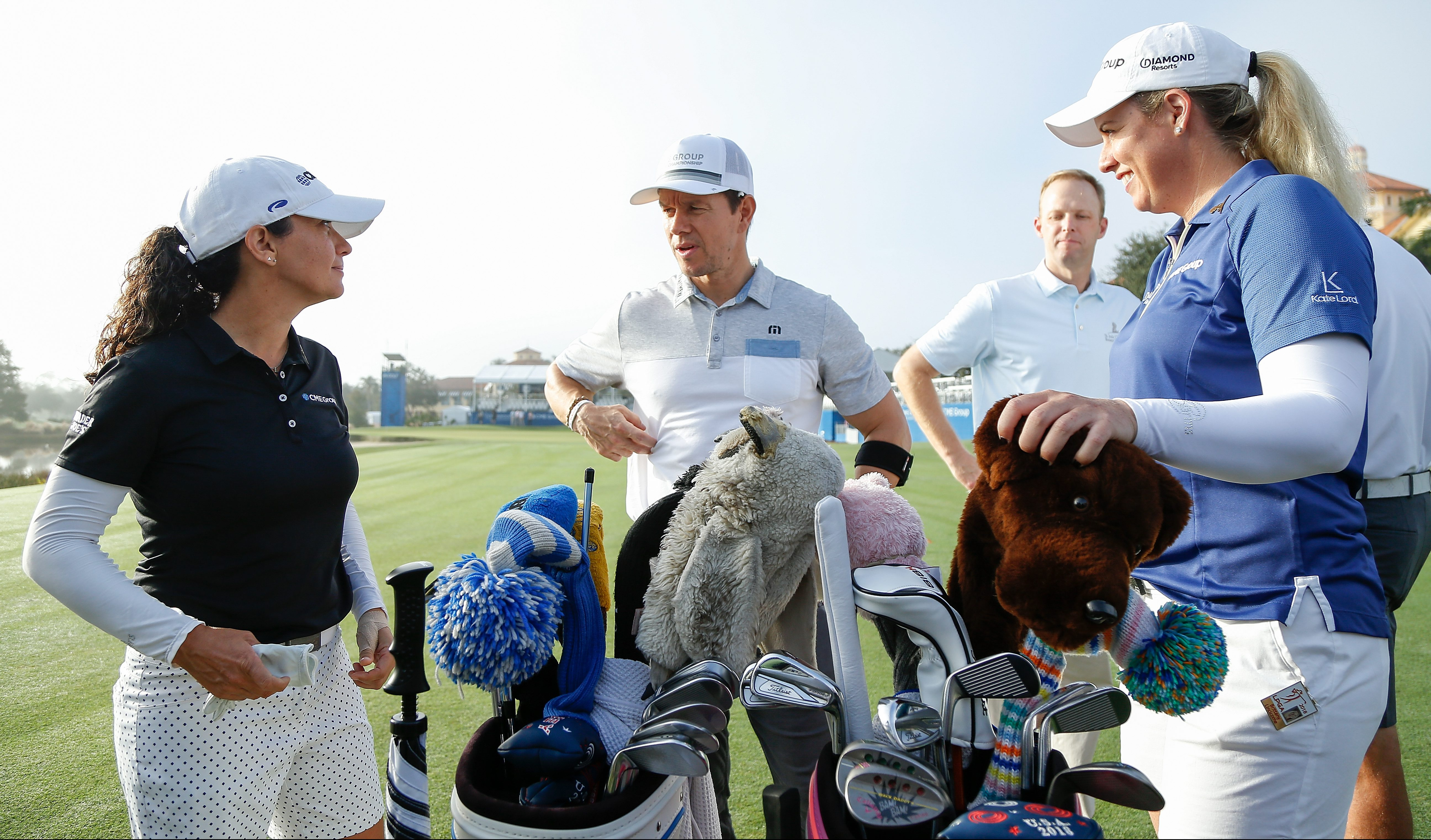 NAPLES, FL - NOVEMBER 14: Actor Mark Wahlberg (center) talks with LPGA golfers Mo Martin (left) and Brittany Lincicome during the CME Group charity event to benefit St. Jude Children's Research Hospital prior to the LPGA CME Group Tour Championship at Tiburon Golf Club on November 14, 2018 in Naples, Florida. (Photo by Michael Reaves/Getty Images)