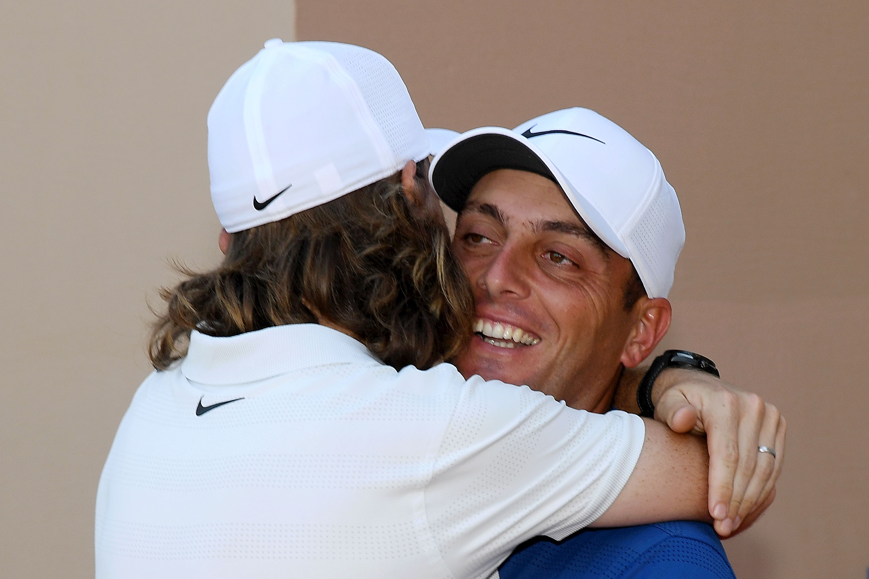 DUBAI, UNITED ARAB EMIRATES - NOVEMBER 18: Tommy Fleetwood of England (L) shakes hands with Francesco Molinari of Italy after Francesco Molinari wins the Race to Dubai during day four of the DP World Tour Championship at Jumeirah Golf Estates on November 18, 2018 in Dubai, United Arab Emirates. (Photo by Ross Kinnaird/Getty Images)