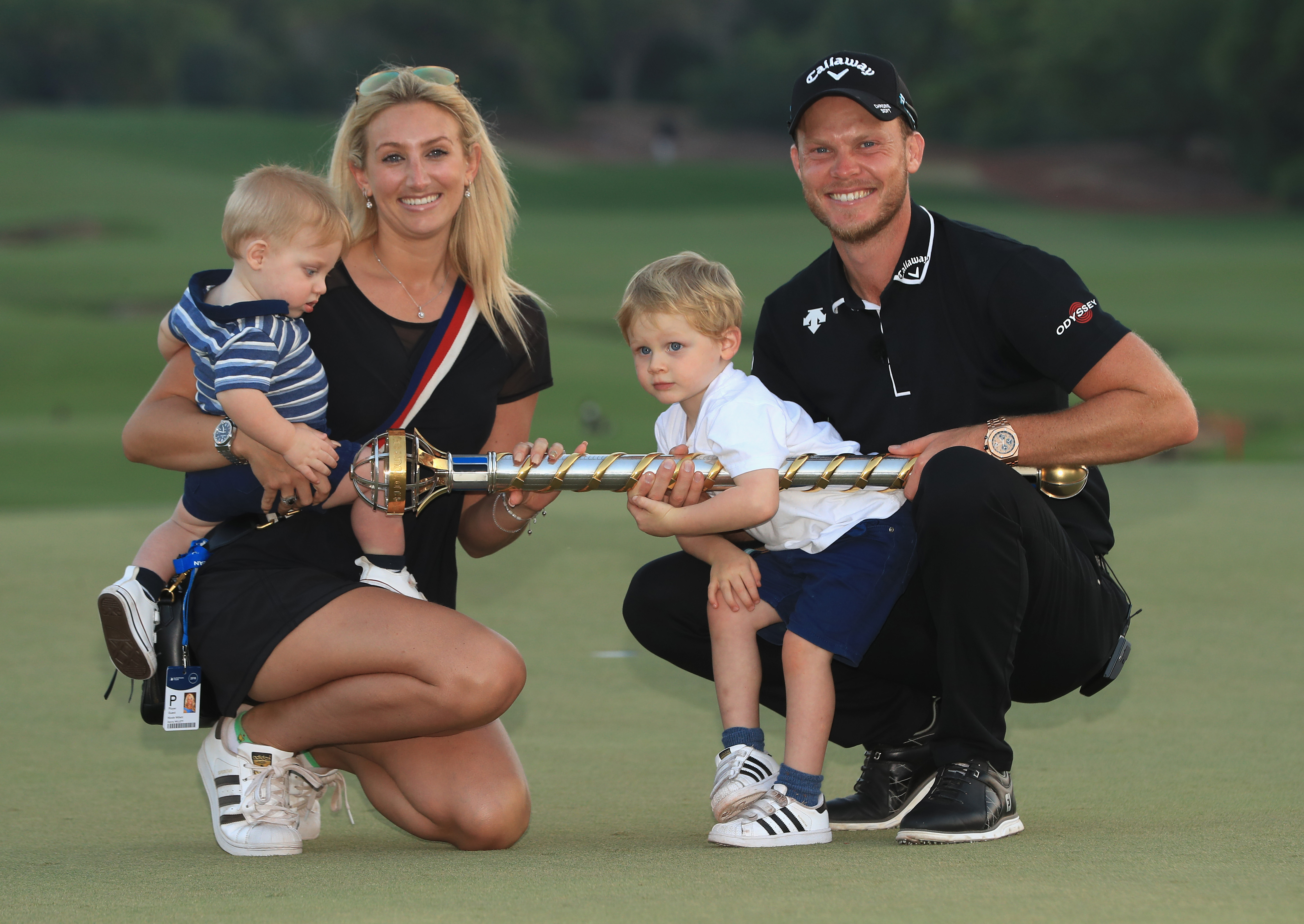 DUBAI, UNITED ARAB EMIRATES - NOVEMBER 18: Danny Willett of England poses with his wife Nicole Willett after winning the DP World Tour Championship at Jumeirah Golf Estates on November 18, 2018 in Dubai, United Arab Emirates. (Photo by Andrew Redington/Getty Images)