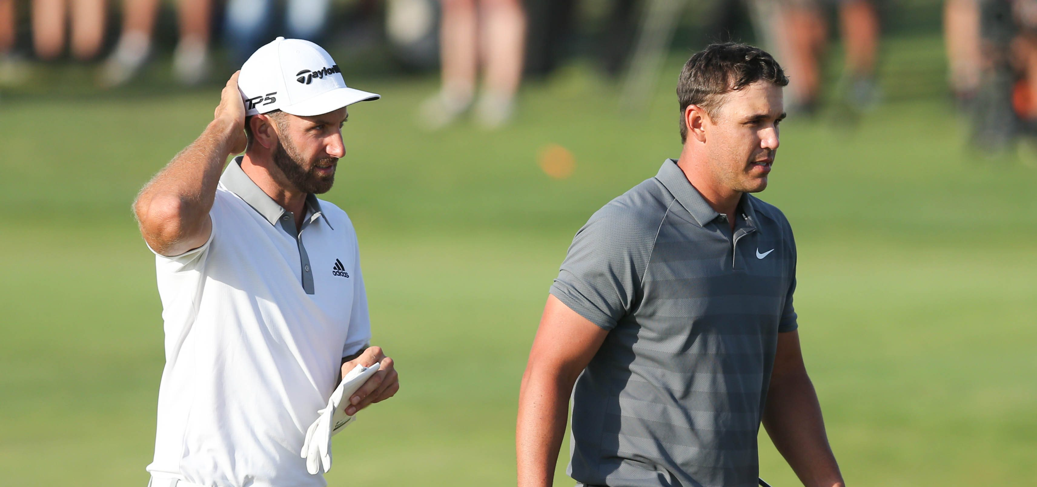 Jun 17, 2018; Southampton, NY, USA; Dustin Johnson and Brooks Koepka walk off the eighteenth green after completing the final round of the U.S. Open golf tournament at Shinnecock Hills GC - Shinnecock Hills Golf C. Mandatory Credit: Brad Penner-USA TODAY Sports