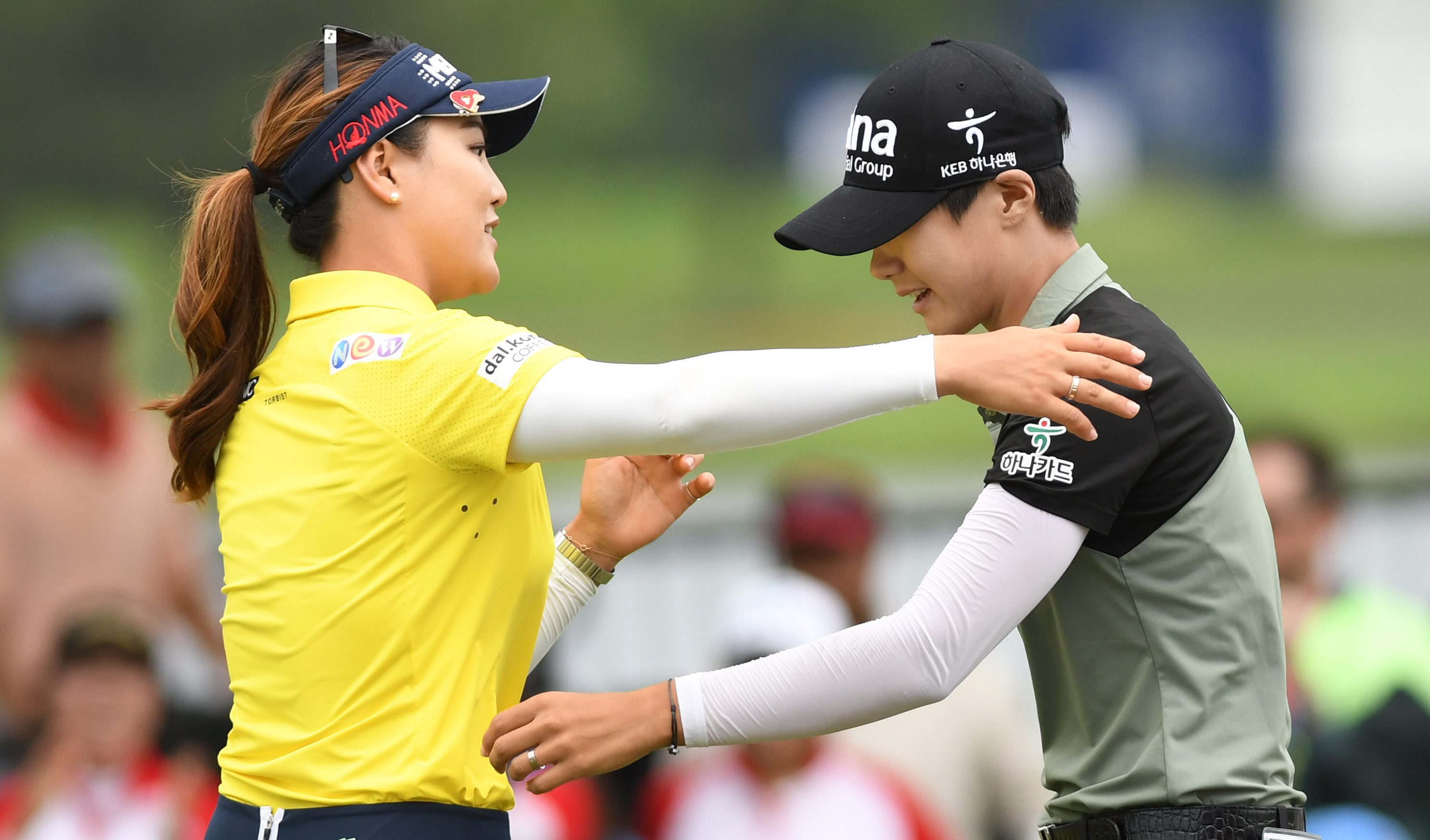 July 1, 2018; Kildeer, IL, USA; So Yeon Ryu (left) hugs Sung Hyun Park (right) after the second playoff hole during the final round of the KPMG Women's PGA Championship golf tournament at Kemper Lakes Golf Club. Mandatory Credit: Thomas J. Russo-USA TODAY Sports