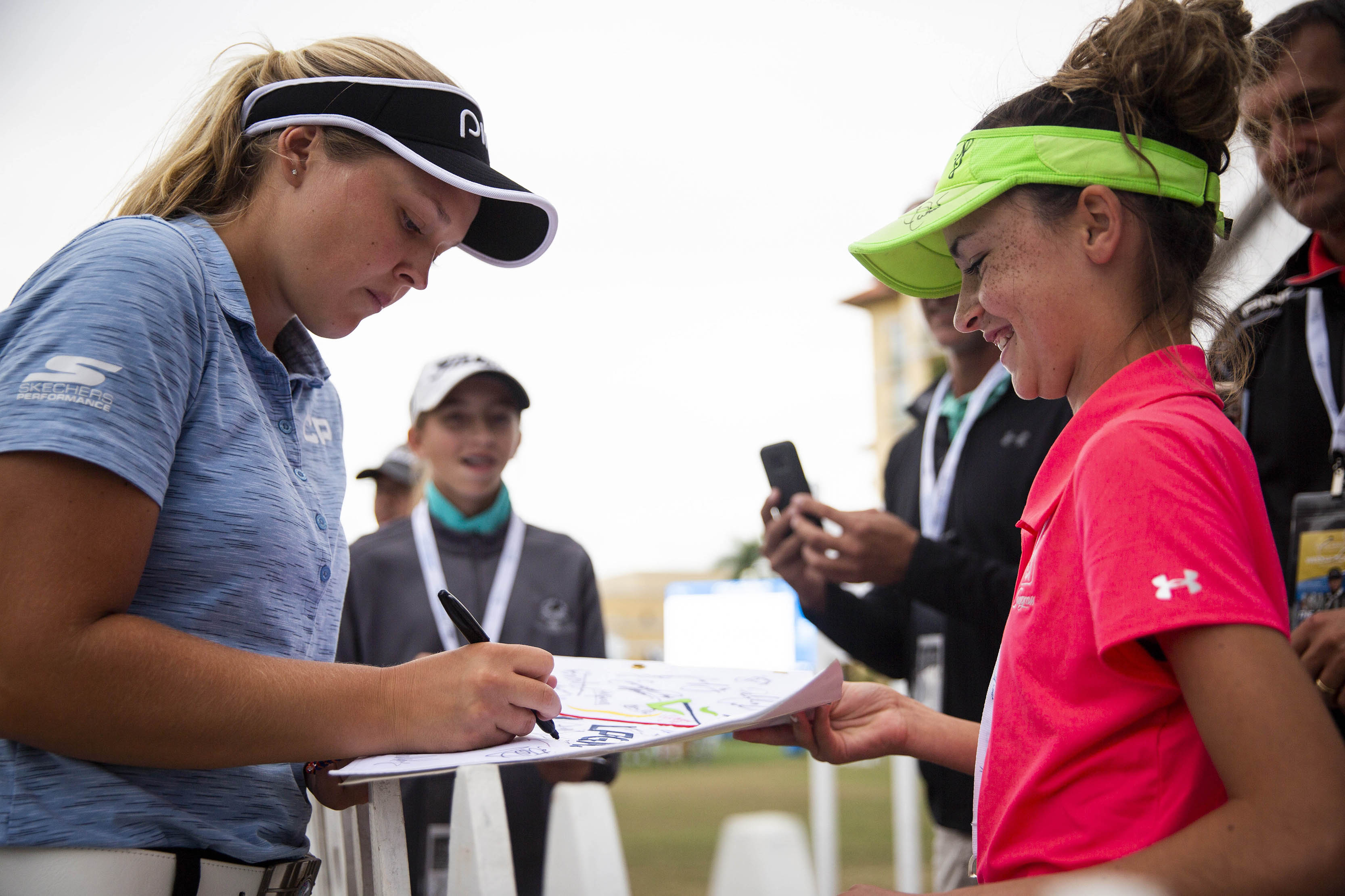 Nov 15, 2018; Naples, FL, USA; Brooke Henderson of Canada signs a flag for Gracie Grant, 12, of Destin, during the CME Group Tour Championship, the final event of the LPGA Tour, on Thursday, November 15, 2018, at Tiburon Golf Club in Naples. Mandatory Credit: Alex Driehaus/Naples Daily News-USA TODAY NETWORK