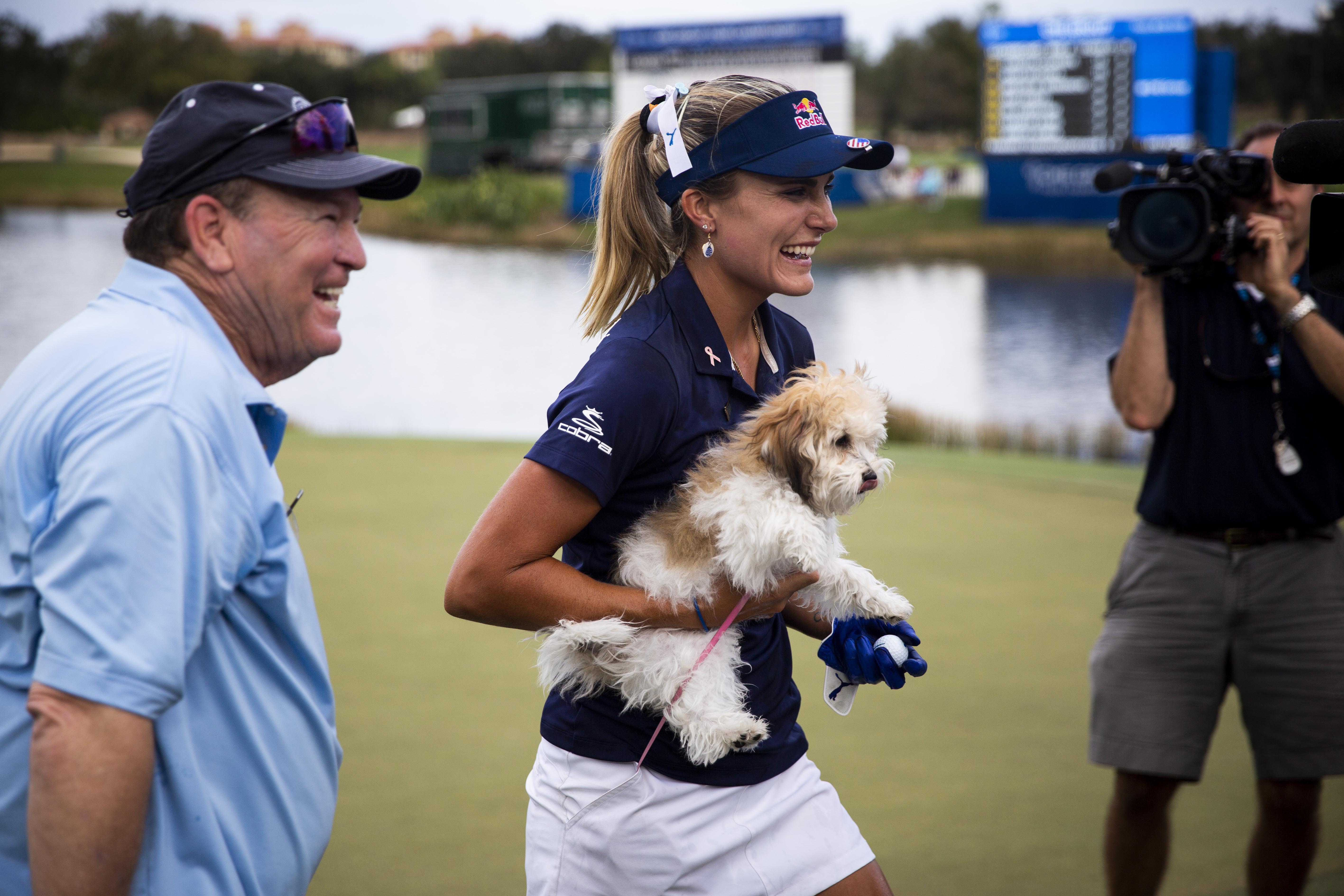 November 18, 2018; Naples, FL, USA; Lexi Thompson carries her dog Leo after winning the CME Group Tour Championship, the final event of the LPGA Tour, on Sunday, November 18, 2018, at Tiburon Golf Club in Naples. Mandatory Credit: Alex Driehaus/Naples Daily News via USA TODAY NETWORK
