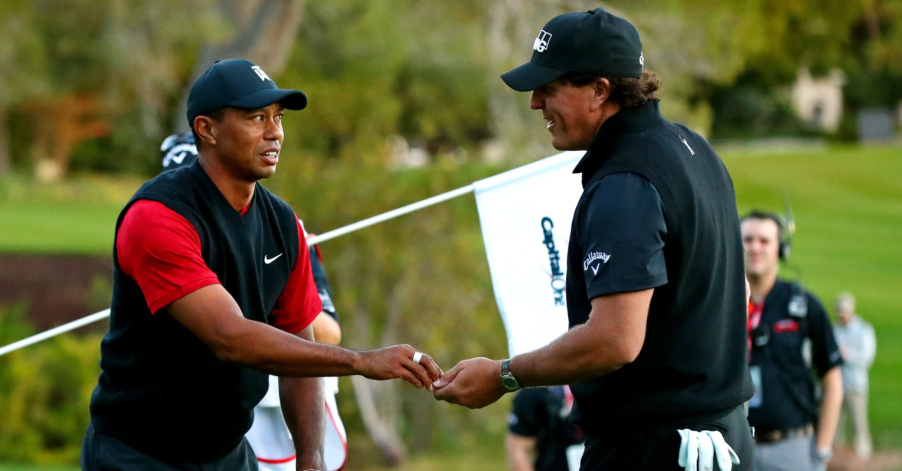Nov 23, 2018; Las Vegas, NV, USA; Tiger Woods concedes a putt to Phil Mickelson to play extra holes during The Match: Tiger vs Phil golf match at Shadow Creek Golf Course. Mandatory Credit: Rob Schumacher-USA TODAY Sports